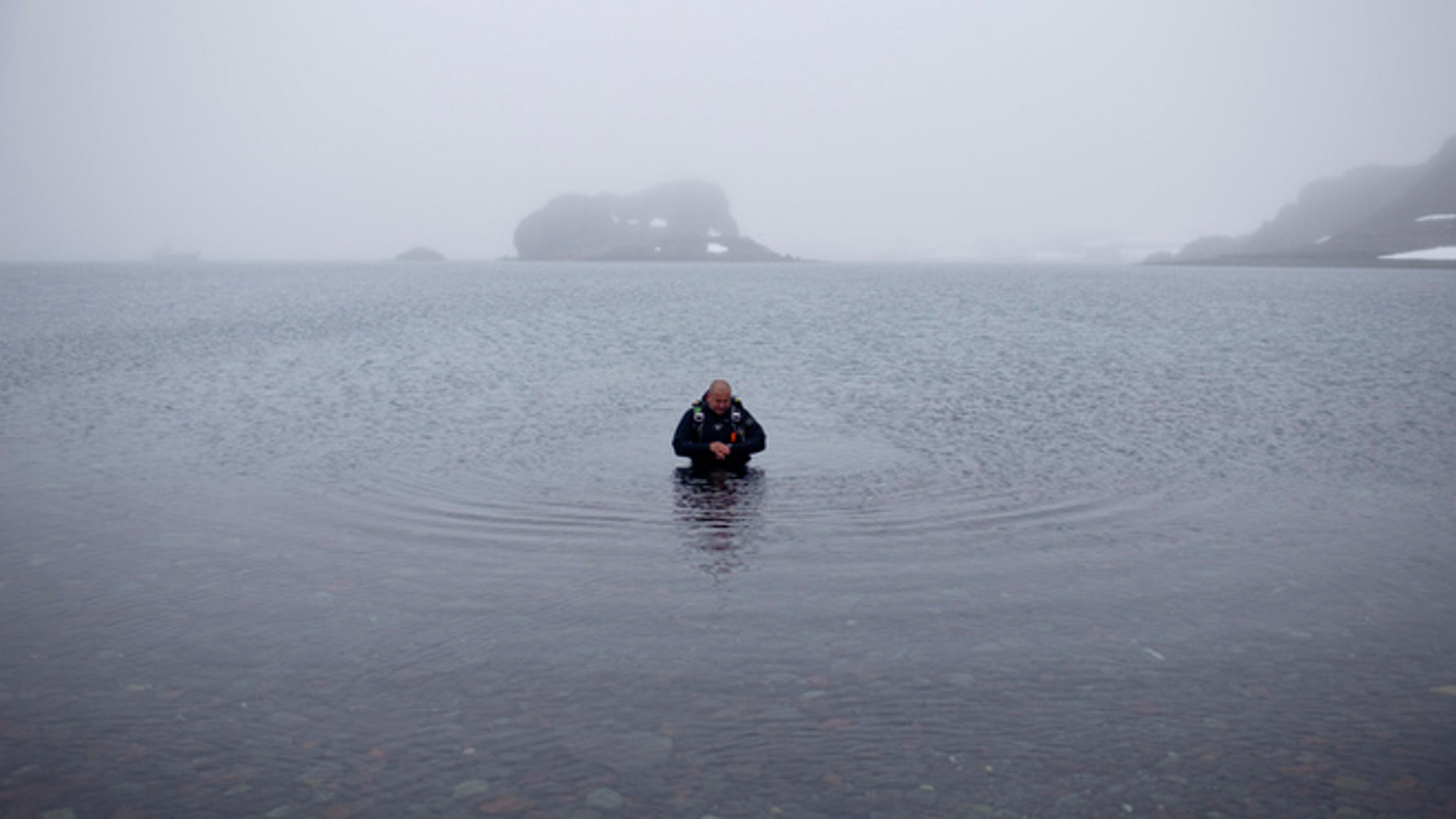 FILE -- Jan. 21, 2015: Scuba diver Luis Torres tests the water at Chilean scientific station Escudero at Villa Las Estrellas, in King George Island, in the South Shetland Islands archipelago of Antarctica.
