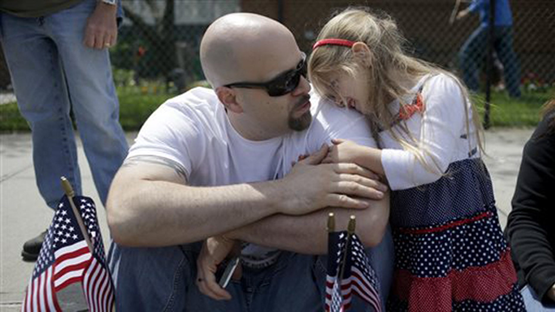 FILE -- Carol Brandt, 3, right, talks with her father Matthew Brandt  during the College Point Memorial Day Parade in New York.