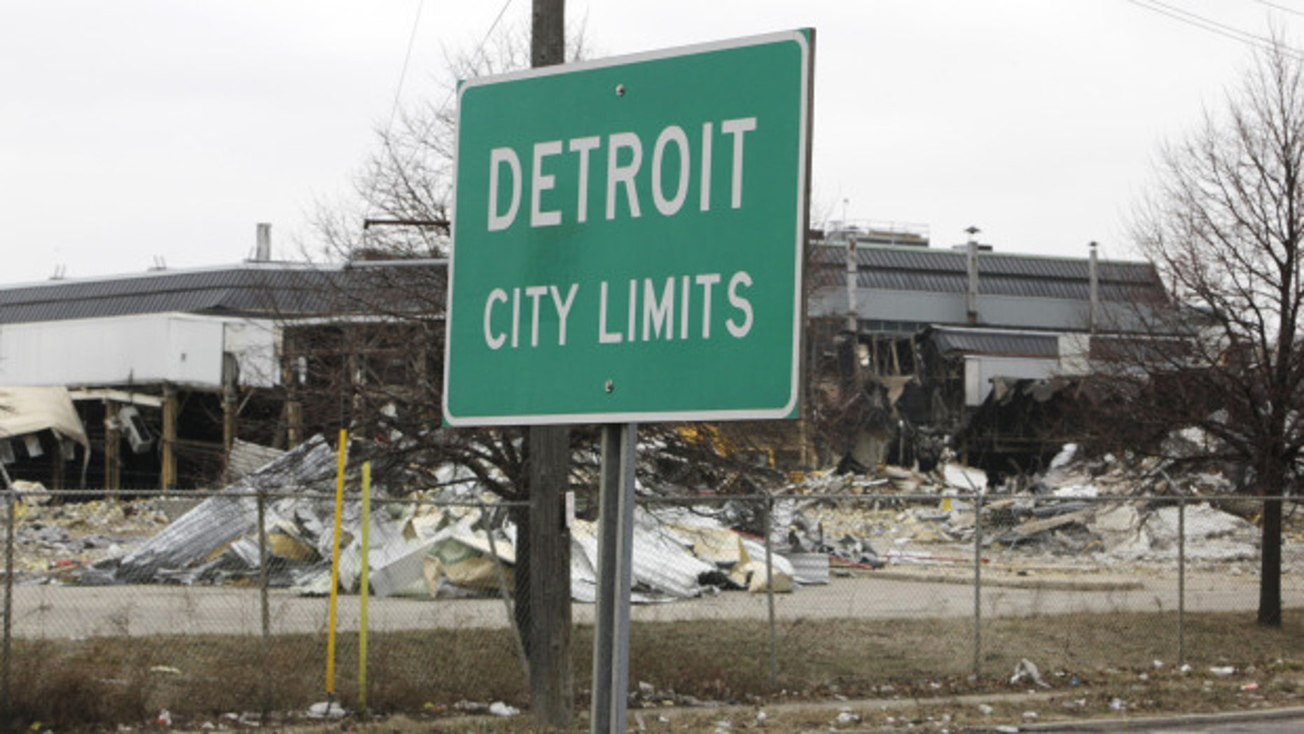 FILE -- A street sign showing Detroit's city limits is shown near where a former Chrysler McGraw glass.