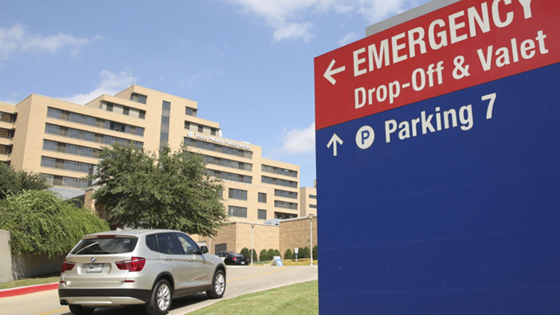 Sept. 30, 2014: A vehicle drives up the driveway to the Texas Health Presbyterian Hospital in Dallas. A patient in the hospital is being teated for Ebola.