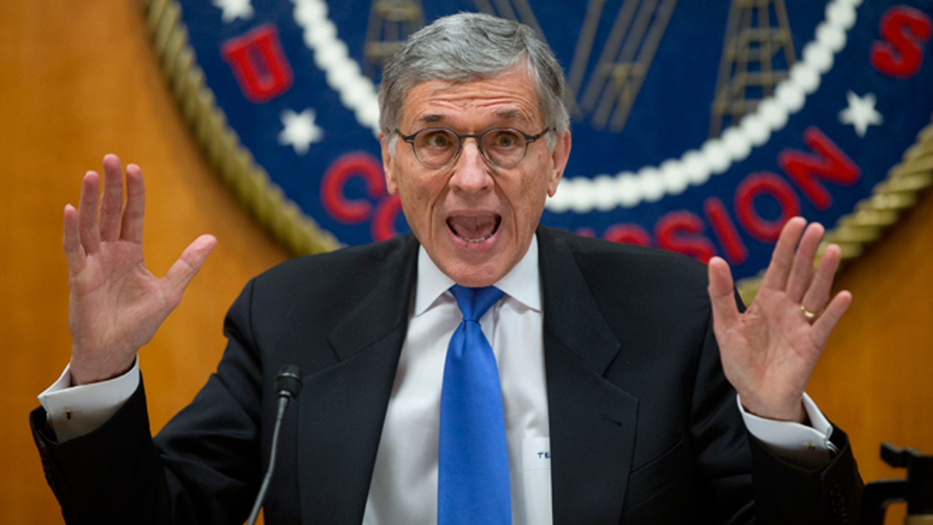 FILE -- Feb. 26, 2015: Federal Communications Commission (FCC) Chairman Tom Wheeler gestures near the end of a hearing for a vote on Net Neutrality at the FCC in Washington. Internet activists scored a major victory after the Federal Communications Commission agreed to rules that would ban service providers from creating Internet fast lanes.