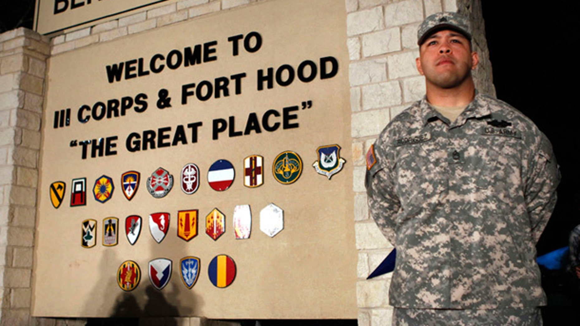 FILE -- April 2, 2014: Sgt. First Class Erick Rodriguez stands guard before a news conference by Lt. Gen. Mark Milley at the entrance to Fort Hood Army Post in Texas.