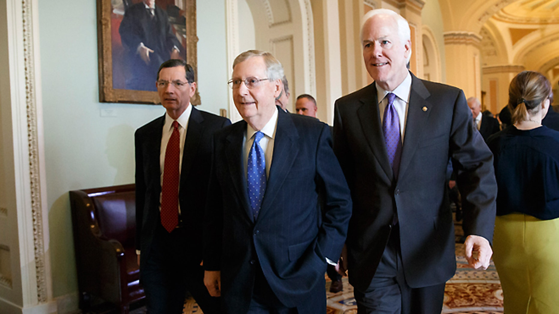 FILE -- Nov. 13, 2014: Senate Minority Leader Mitch McConnell of Ky., flanked by Sen. John Barrasso, R-Wyo., left, and Senate Minority Whip John Cornyn of Texas, emerges from a closed-door meeting on Capitol Hill in Washington, where he was chosen by acclamation of the GOP rank-and-file to be the new Senate majority leader when the new Congress convenes in January.