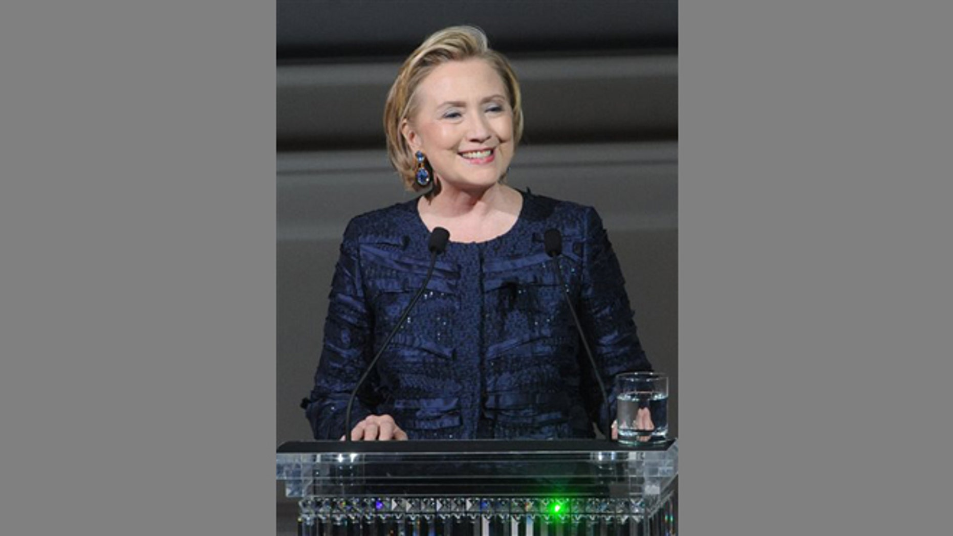 FILE -- June 3, 2013: Former Secretary of State Hillary Rodham Clinton speaks on stage during the 2013 CFDA Fashion Awards at Alice Tully Hall in New York.
