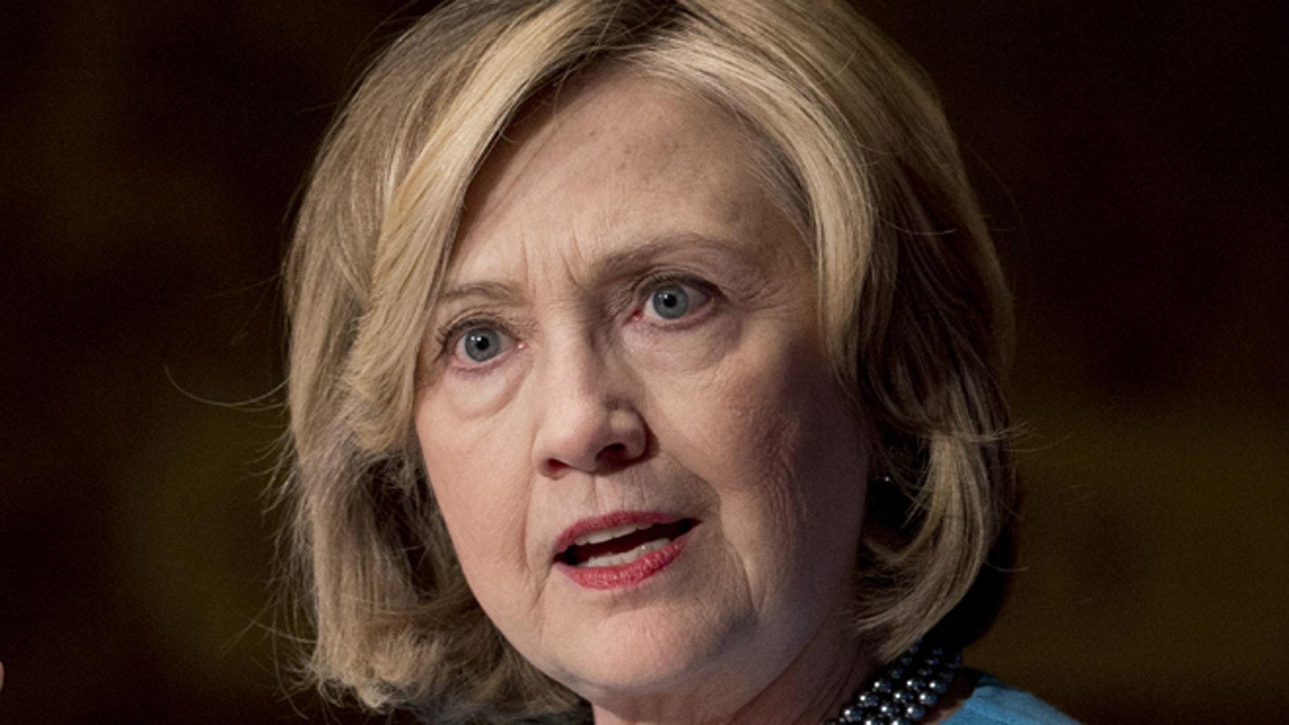 FILE - Dec. 3, 2014: Former Secretary of State Hillary Rodham Clinton speaks in Gaston Hall at Georgetown University, in Washington.