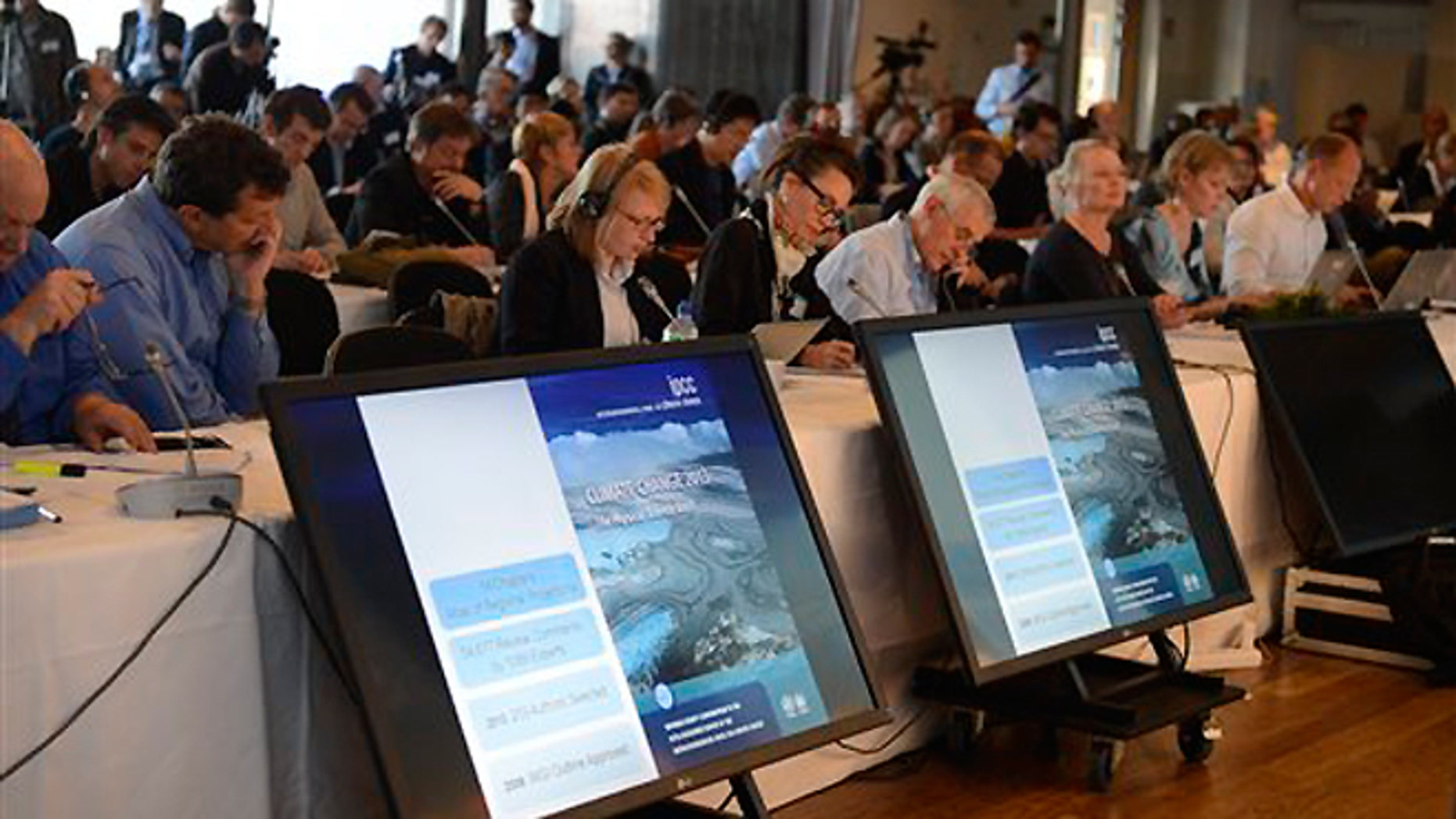 Sept. 27, 2013: Media representatives follow the U.N. IPCC climate report presentation, in Stockholm.