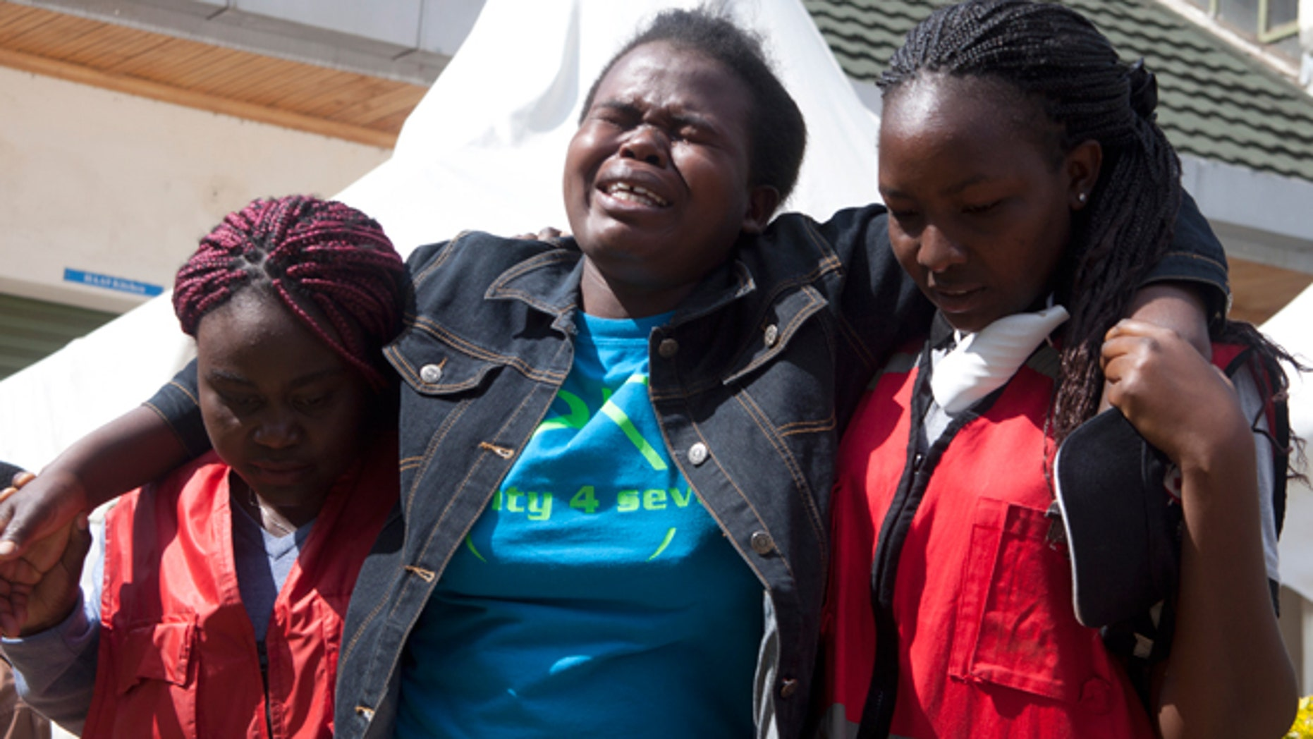 April 8, 2015: Kenya Red Cross staff help a woman after she viewed the body of a relative killed in last Thursday's attack on Garissa University College in northeastern Kenya, at Chiromo funeral home, Nairobi, Kenya.  Al-Shabab gunmen rampaged through the university at dawn Thursday, killing over 140 people in the group's deadliest attack in the East African country.