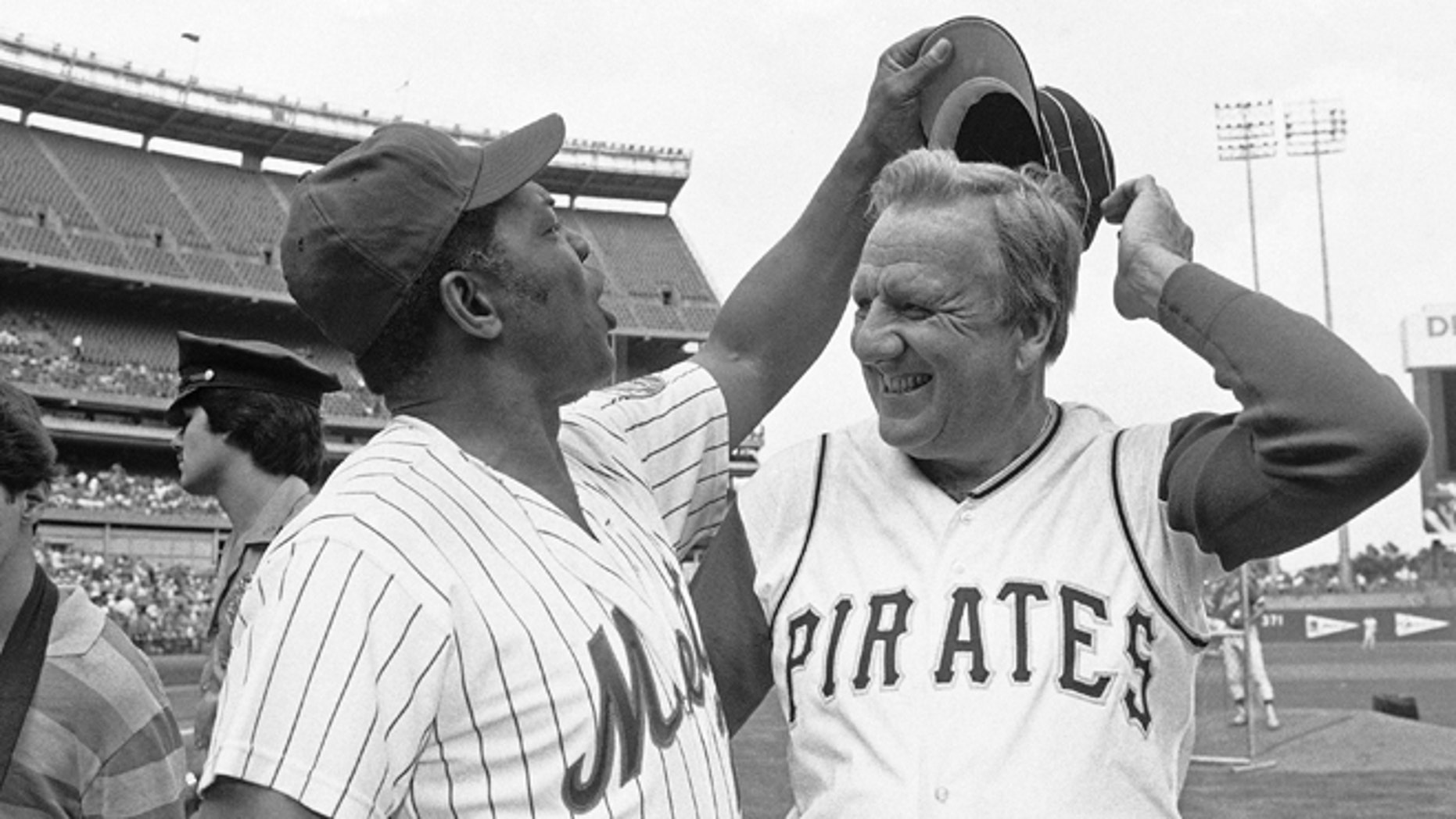 FILE - In this Aug. 14, 1982 file photo, Willie Mays tries to get Ralph Kiner's hat as the two Hall of Famers pose for pictures before the start of Old Timers Day game at Shea Stadium in New York. The baseball Hall of Fame slugger died on Feb. 6, 2014, at his home in Rancho Mirage, Calif. He was 91.