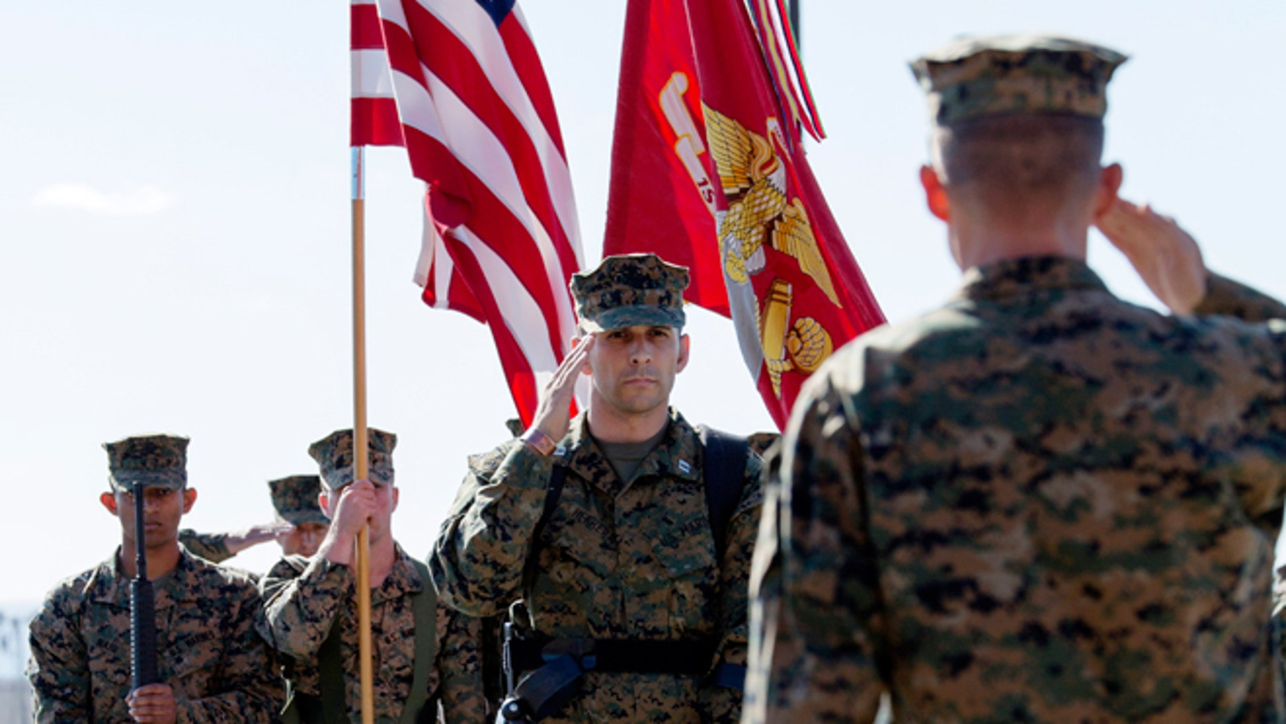 Nov. 21, 2014: In this photo provided by the U.S. Marines, U.S. Marine Capt. Derek Herrera, center, 1st Marine Special Operations Battalion, salutes during his awards and retirement ceremony at Camp Pendleton, Calif.