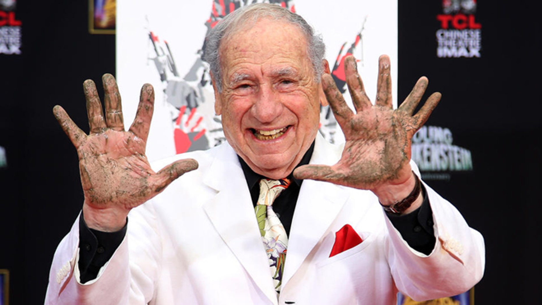 "FILE -- Sept. 8, 2014: Director/Comedian Mel Brooks displays his cement-covered hands, including one with a prosthetic finger, during his Hand and Footprint ceremony marking the 40th anniversary of the movie ""Young Frankenstein,"" in front of the TCL Chinese Theatre in the Hollywood section of Los Angeles."