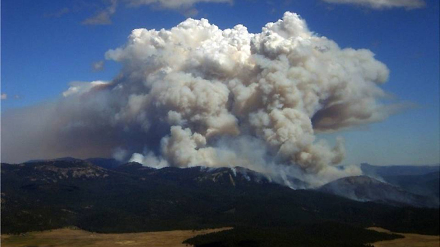 Smoke rises from the Moonlight fire, which burned in Plumas and Lassen counties in California for 22 days in September 2007.
