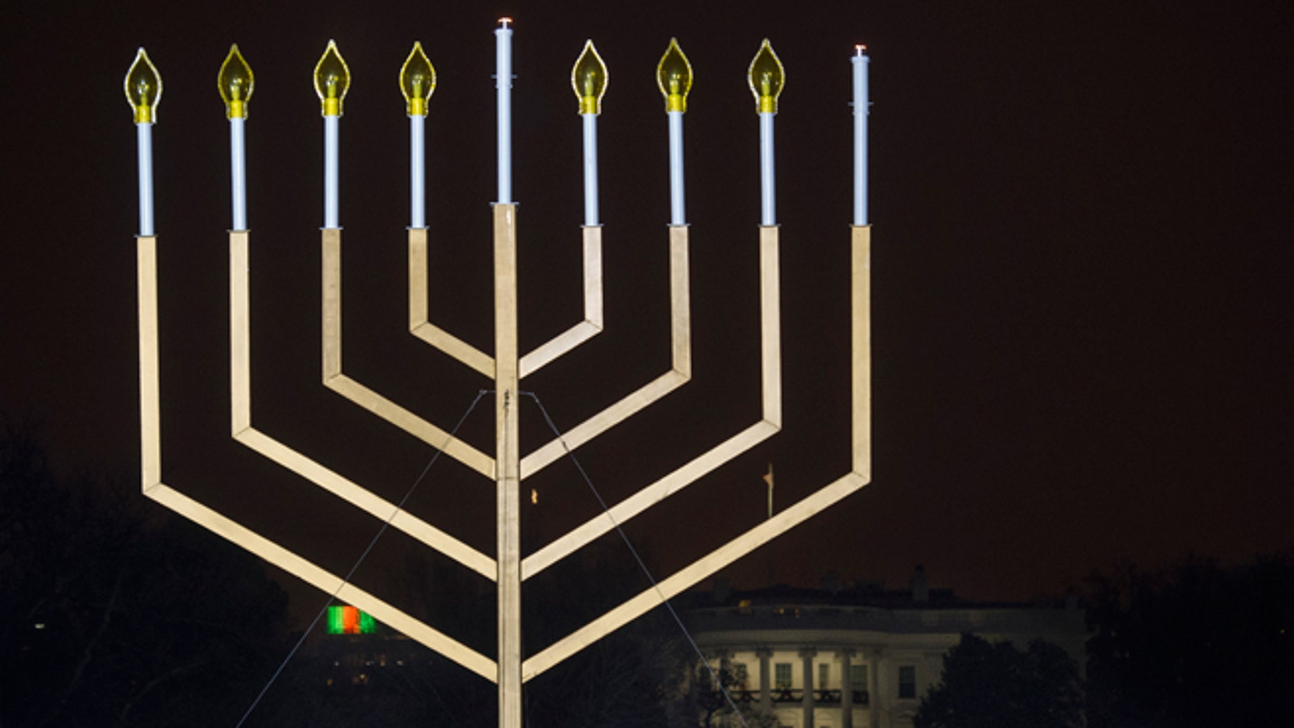 Dec. 16, 2014: The White House is in the background after the national menorah was lit during a ceremony marking the start of the celebration of Hanukkah, on the Ellipse near the White House in Washington.