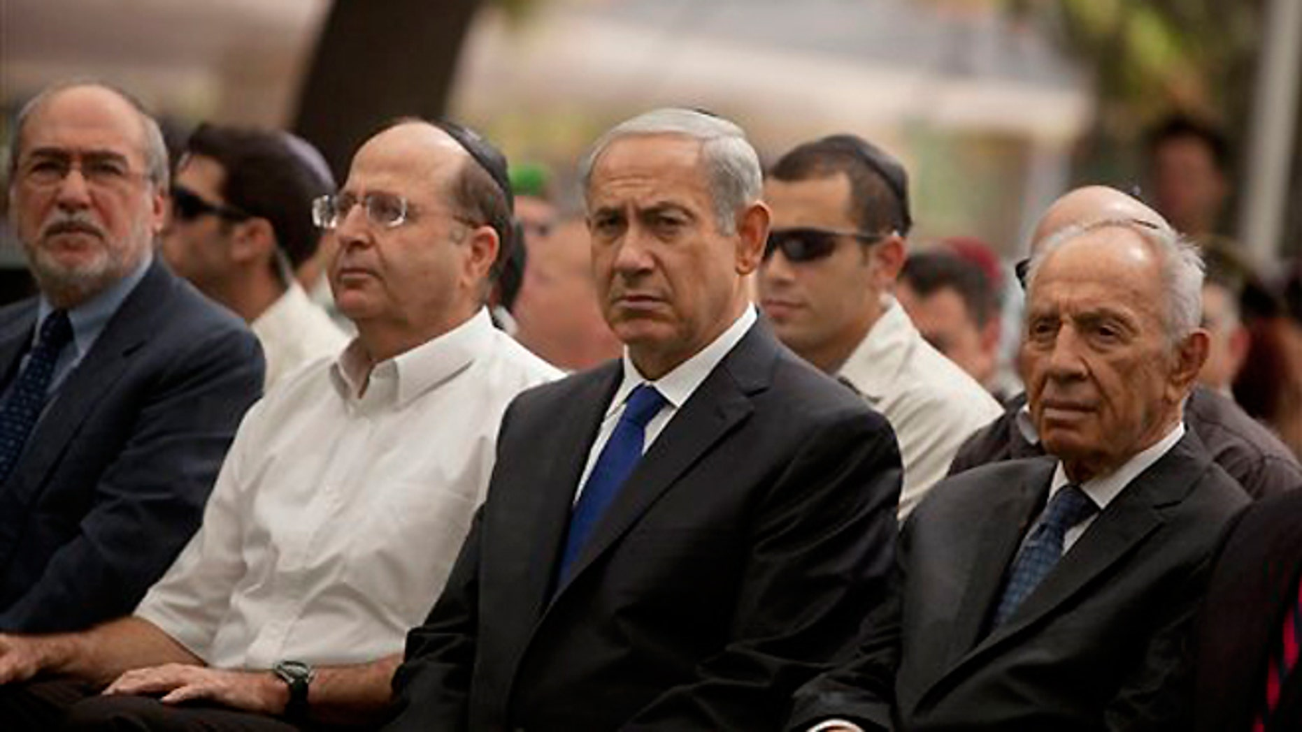 FILE -- Sept. 15, 2013: Israeli Prime Minister Benjamin Netanyahu, center, sits with Israeli President Shimon Peres, right, and Israeli Defense Minister Moshe Yaalon during the state memorial ceremony for soldiers, fallen during the 1973 Arab-Israel War, which Israelis call the Yom Kippur War, in Jerusalem.