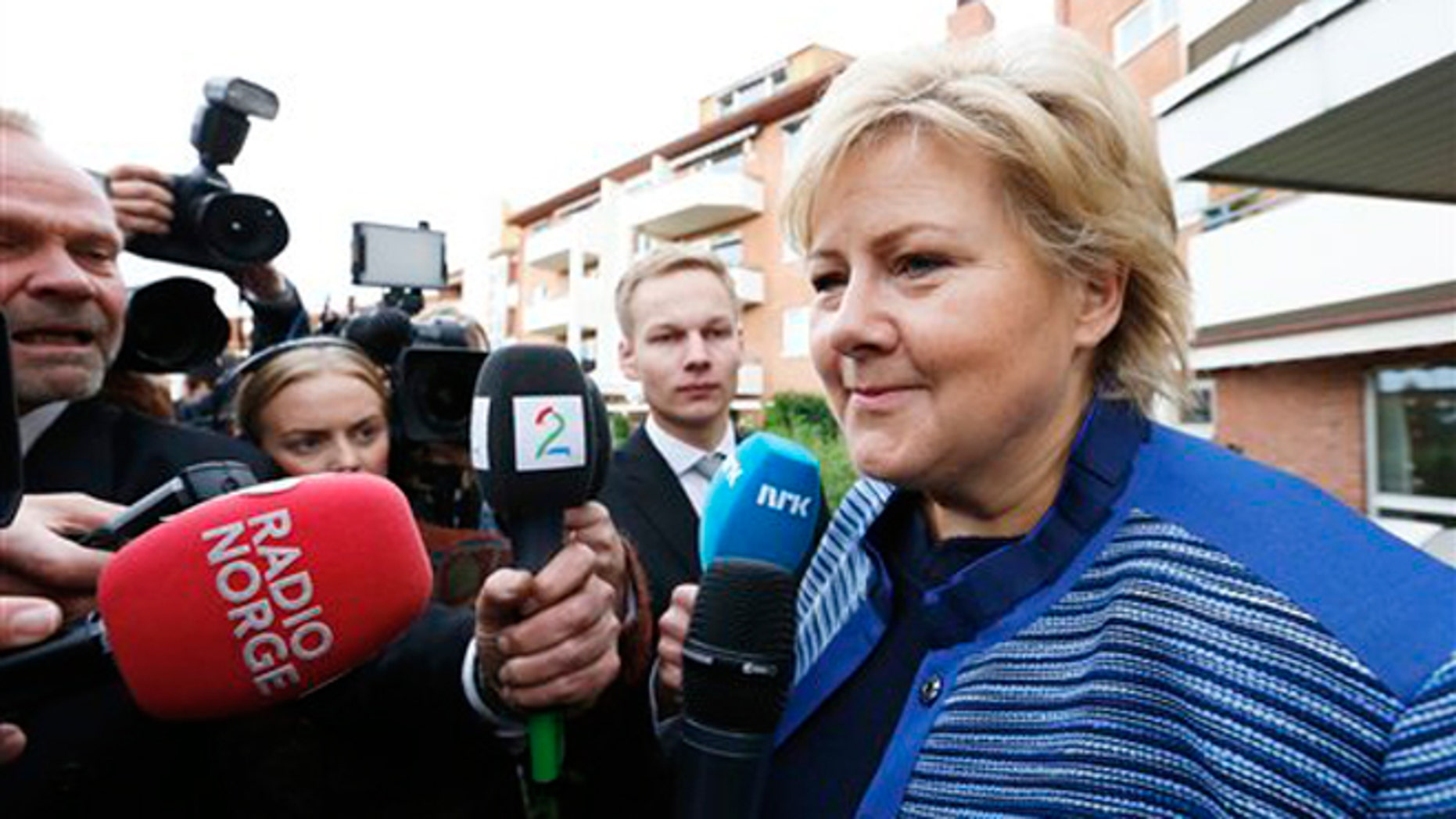 "Sept. 10, 2013: Chairman of the Conservative Party in Norway, Erna Solberg, meets the press outside the block of apartments where she lives in Oslo the day after she and her party returned a resounding victory in the general elections. Solberg nicknamed ""Iron Erna"" will become Norway's new prime minister as the leader of a center-right coalition government likely including an anti-immigration party."