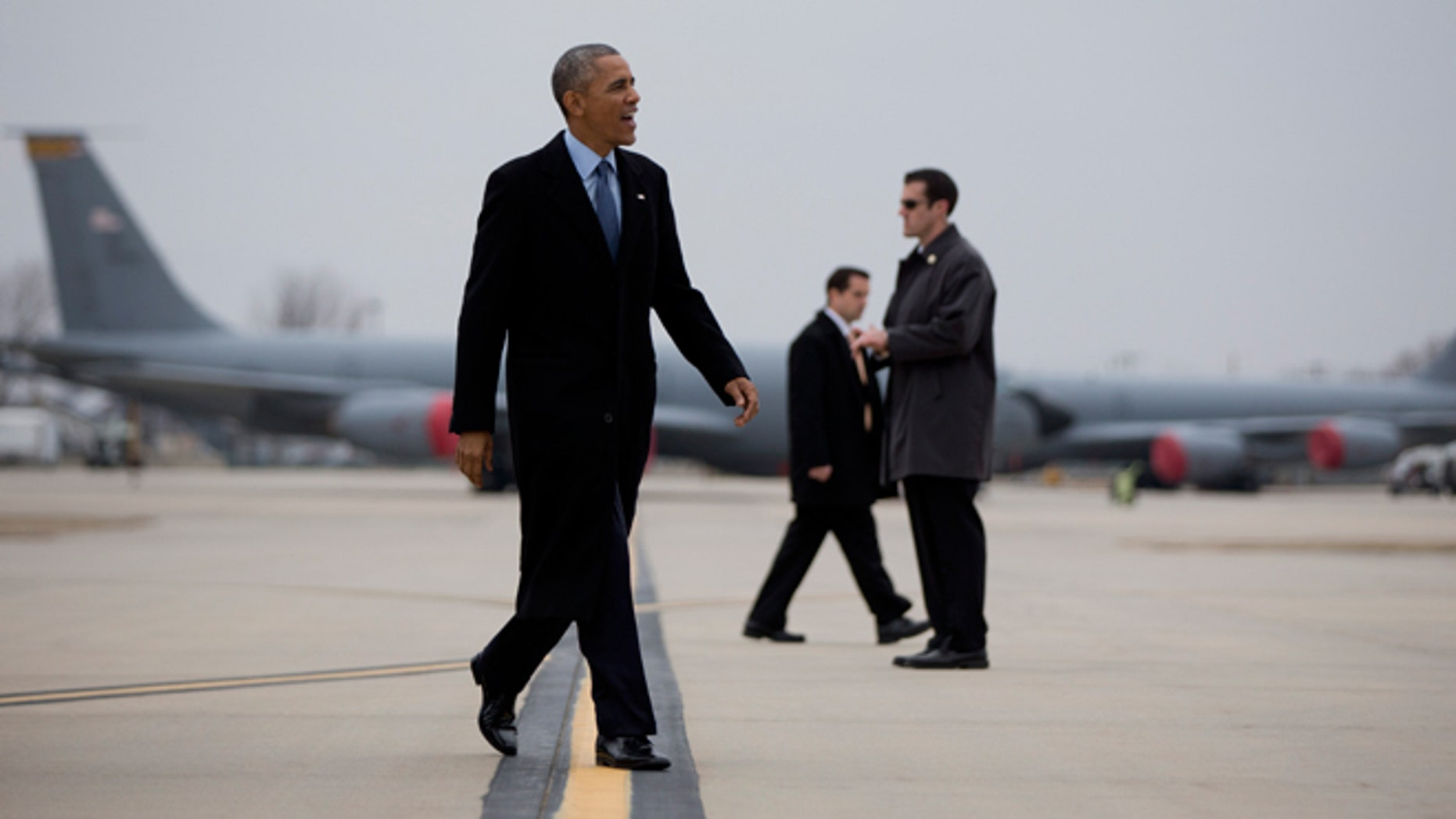 Jan. 22, 2015: President Obama walks to board Air Force One at Forbes Field Airport in Topeka, Kansas, en route to Washington, after speaking at the University of Kansas in Lawrence, Kansas.
