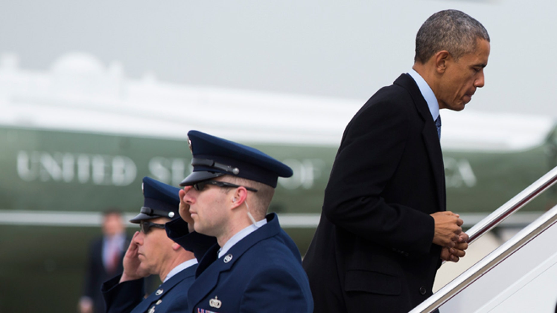 Feb. 25, 2015: President  Obama boards Air Force One at Andrews Air Force base, Md., for a trip to Miami.