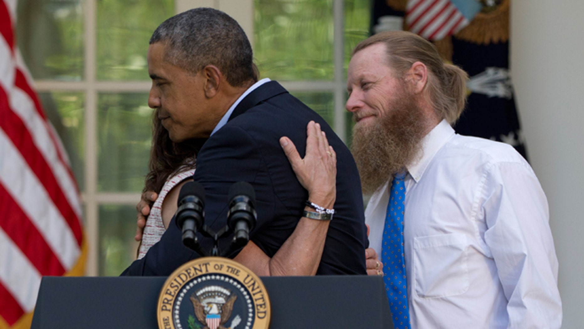 President Obama hugs Jani Bergdahl, as Bob Bergdahl, stands at right, during a news conference in the Rose Garden of the White House in Washington, Saturday, May 31, 2014 about the release of their son, U.S. Army Sgt. Bowe Bergdahl, from captivity. Bergdahl, 28, had been held prisoner by the Taliban since June 30, 2009. He was handed over to U.S. special forces by the Taliban in exchange for the release of five Afghan detainees held by the United States.