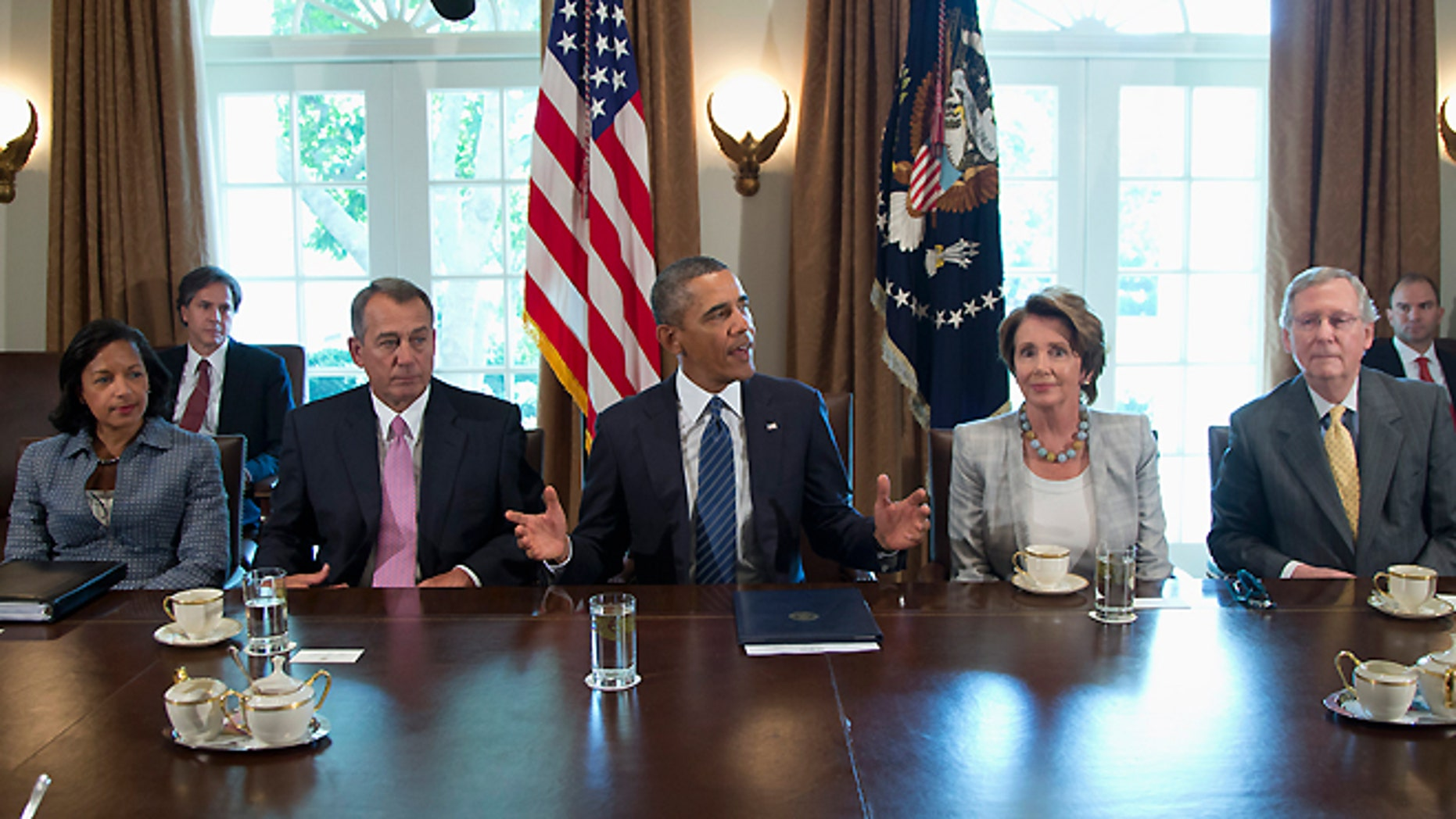 Sept. 3, 2013: President Obama speaks to media in the Cabinet Room of the White House in Washington before a meeting with Congressional leaders to discuss the situation in Syria. From left are, National Security Adviser Susan Rice, House Speaker John Boehner of Ohio, the president, House Minority Leader Nancy Pelosi of Calif., and Senate Minority Leader Mitch McConnell of Ky.