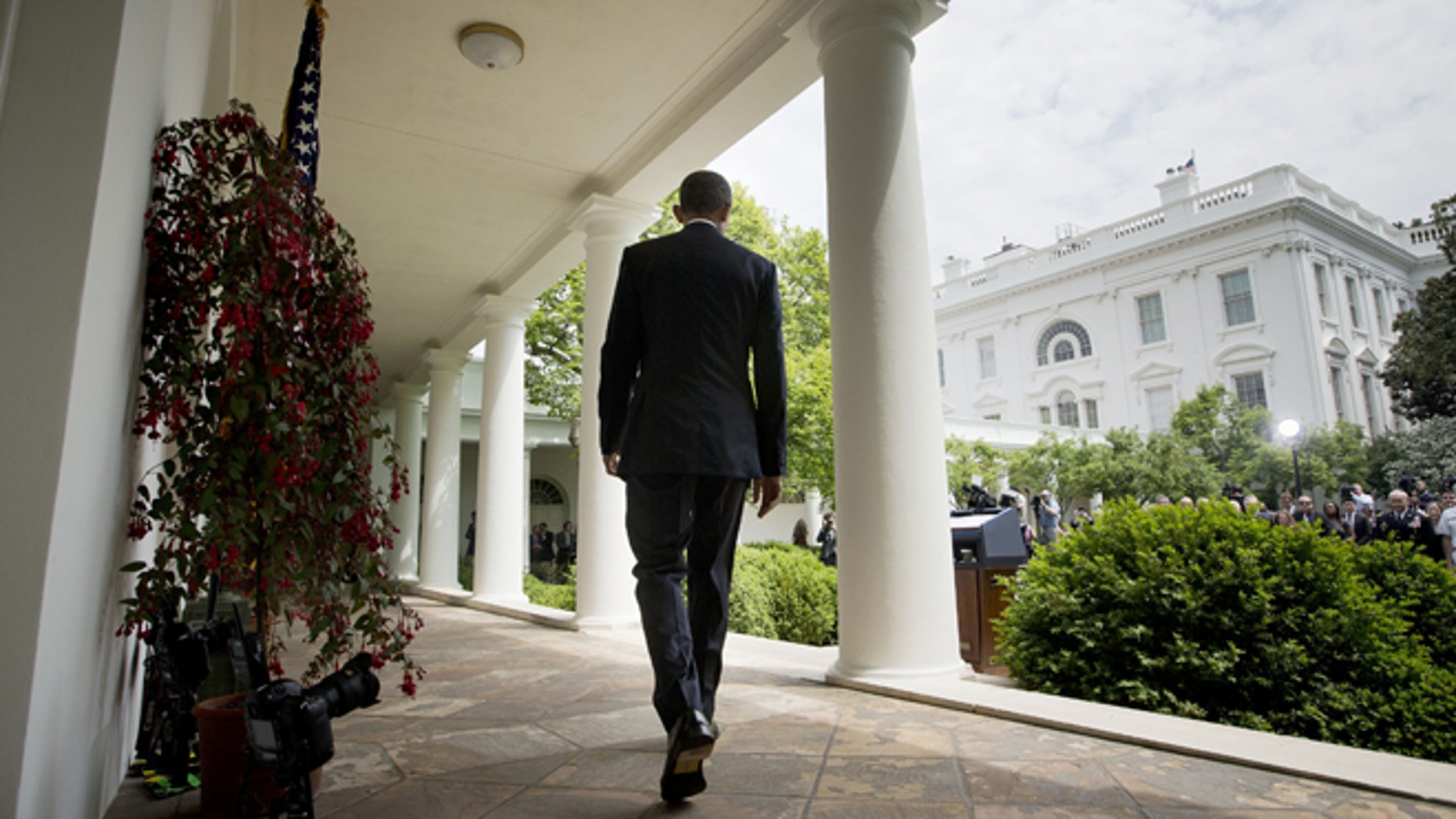May 5, 2015: President Obama walks to the Rose Garden of the White House in Washington.