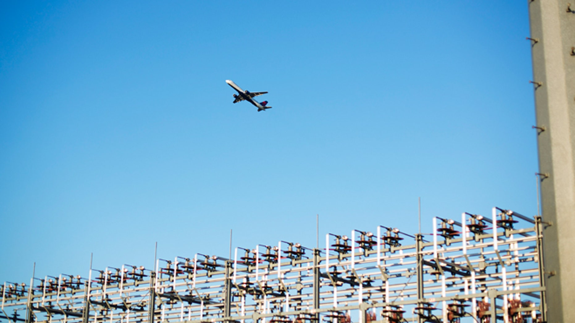 FILE -- Aug. 27, 2014: An airplane takes off from Hartsfield-Jackson International Airport in Atlanta.