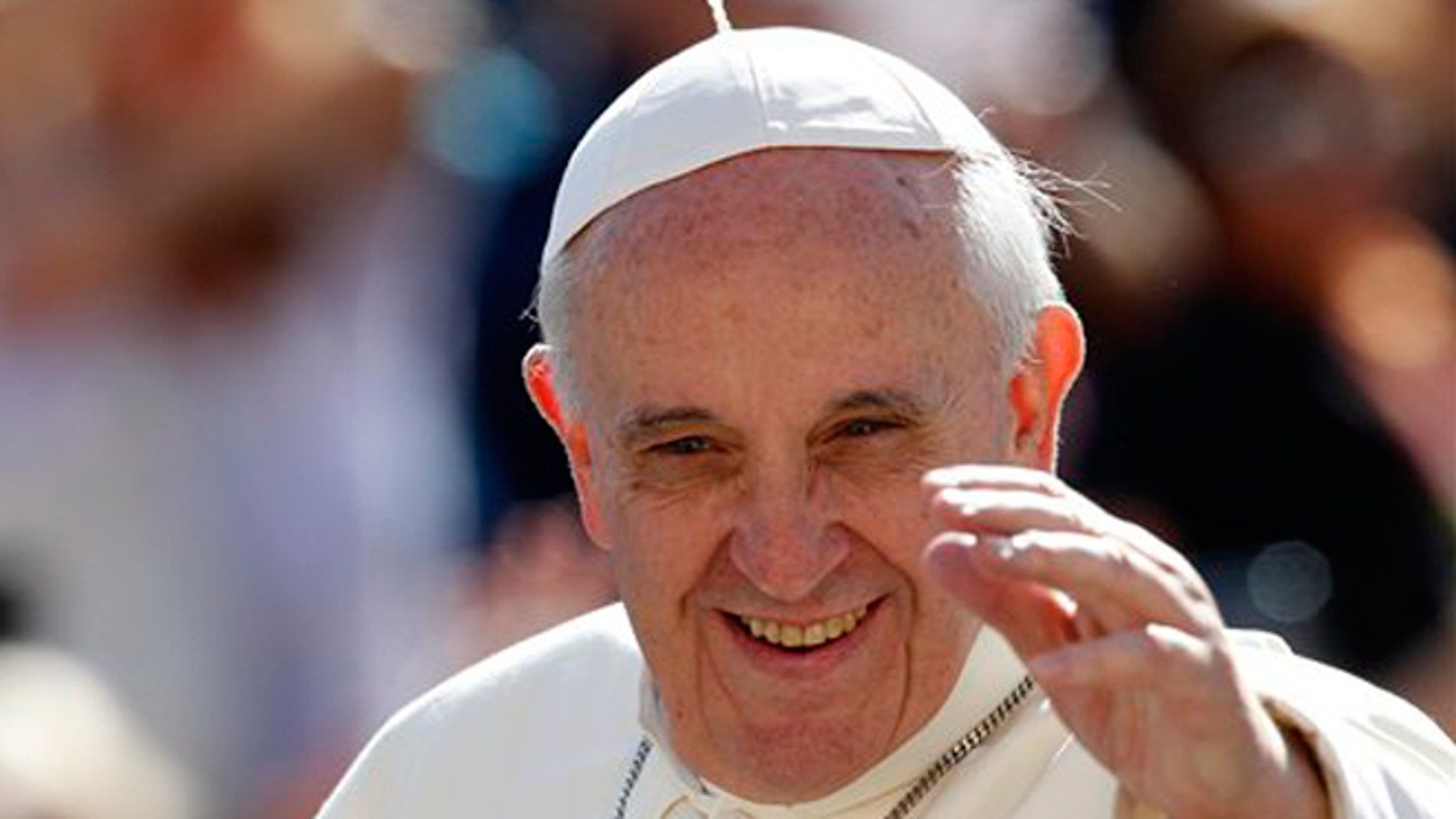 FILE -- Sept. 18, 2013: Pope Francis waves to faithful as he arrives for his weekly general audience in St. Peter's Square at the Vatican.
