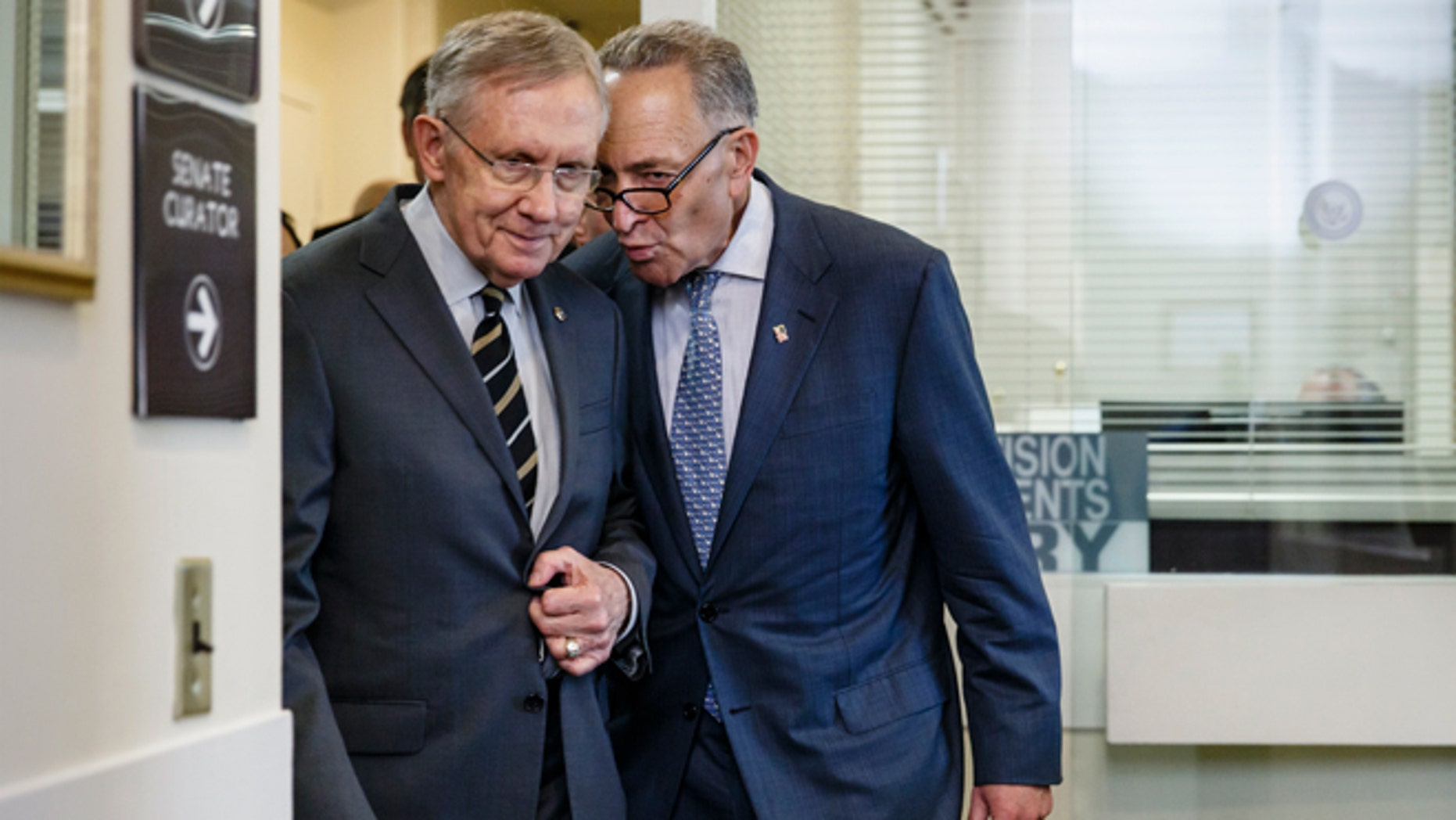 April 30, 2014: Sen. Charles Schumer, D-N.Y., the Democratic Policy Committee chairman, right, confers with Senate Majority Leader Harry Reid of Nev., on Capitol Hill in Washington, after a bill to raise the minimum wage was stopped in the Senate.