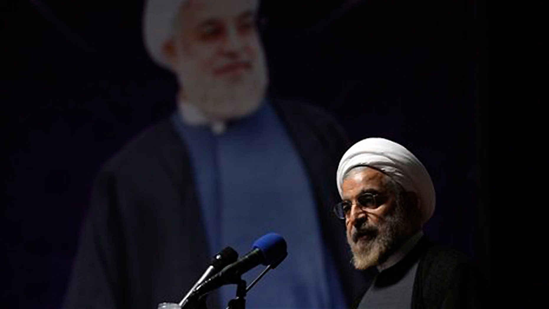 FILE -- May 2, 2013: Iranian President Hasan Rouhani delivers a speech during his campaign for the presidential election in Tehran, Iran. The U.N. has slotted the new moderate-leaning president to address the global gathering of leaders on Sept. 24 -- just hours after U.S. President Barack Obama is scheduled to wrap up his speech.