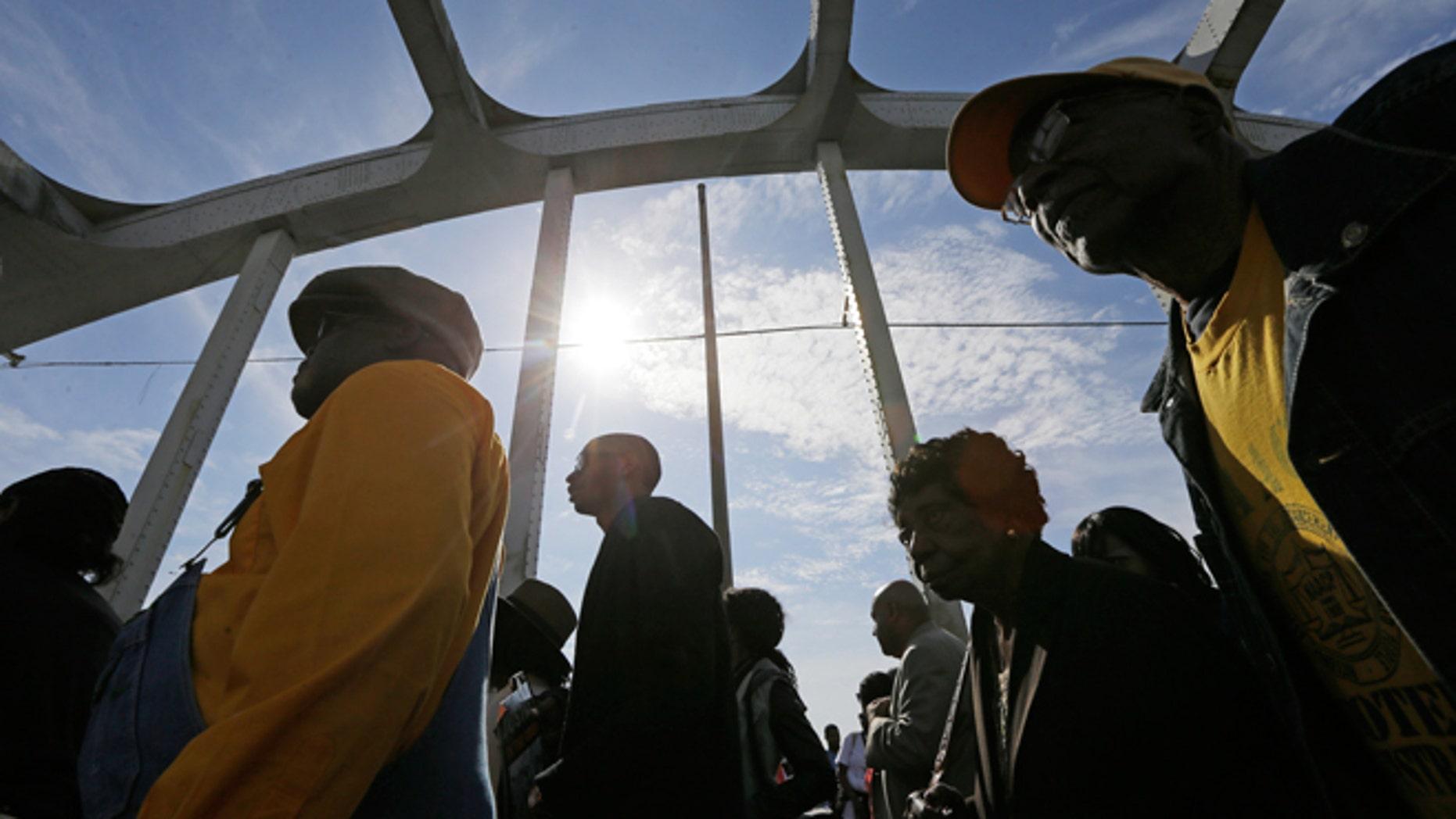 March 8, 2015: Crowds of people walk toward Selma after taking a symbolic walk across the Edmund Pettus Bridge in Selma, Ala.