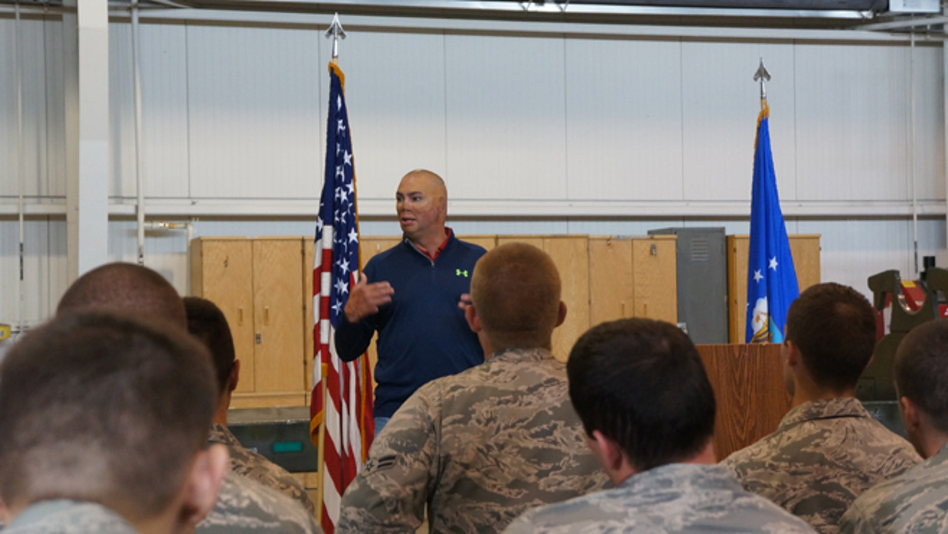 Author Shilo Harris speaks at Minot Air Force Base in North Dakota.
