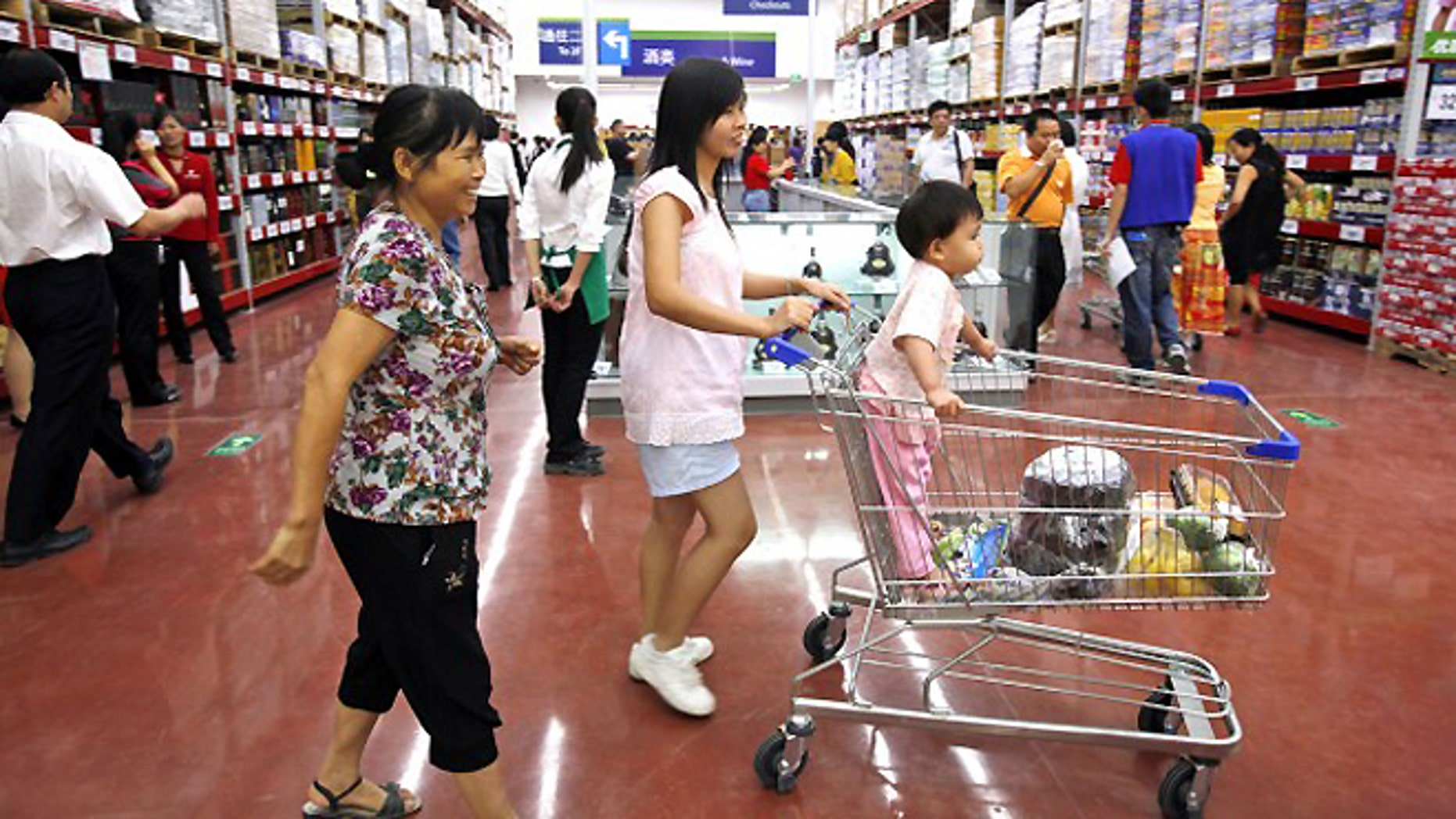 FILE -- Chinese customers shop at Walmart's first Sam's Club in China's southern city, Guangzhou.