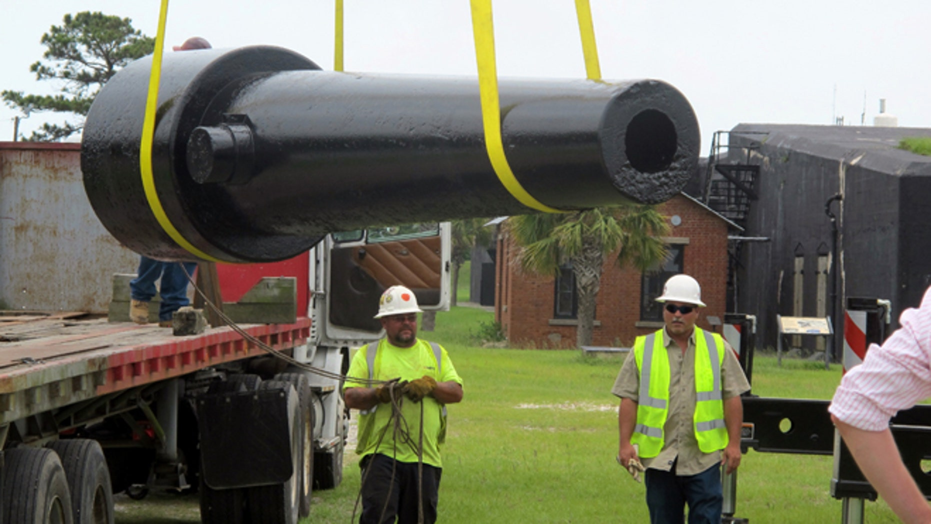 June 10, 2013: Workers move a Civil War cannon into position at Fort Moultrie on Sullivans Island, S.C.,  after the gun was conserved.