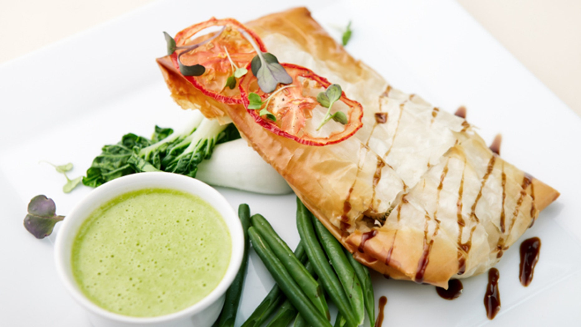 Chilean sea bass in papilliote with sauce - iStock Photo