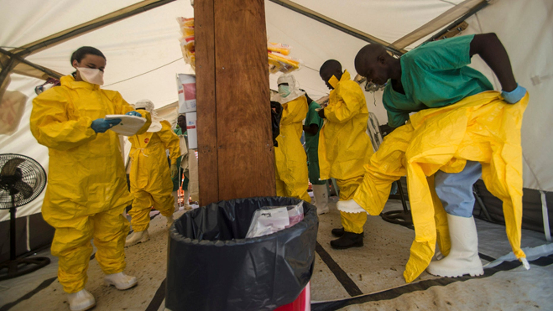 Medical staff working with Medecins sans Frontieres (MSF) put on their protective gear before entering an isolation area at the MSF Ebola treatment centre in Kailahun July 20, 2014. Sierra Leone now has the highest number of Ebola cases, at 454, surpassing neighbouring Guinea where the outbreak originated in February. Picture taken July 20, 2014.    REUTERS/Tommy Trenchard (SIERRA LEONE - Tags: HEALTH) - RTR40DKX