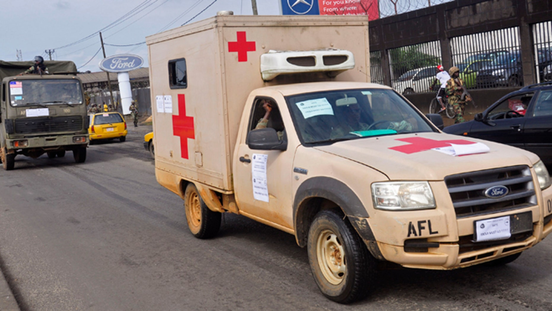 Aug. 1, 2014: Liberian soldiers in a medical truck drive past as they patrol streets to prevent panic, as fears of the deadly Ebola virus spread in the city of Monrovia, Liberia,.