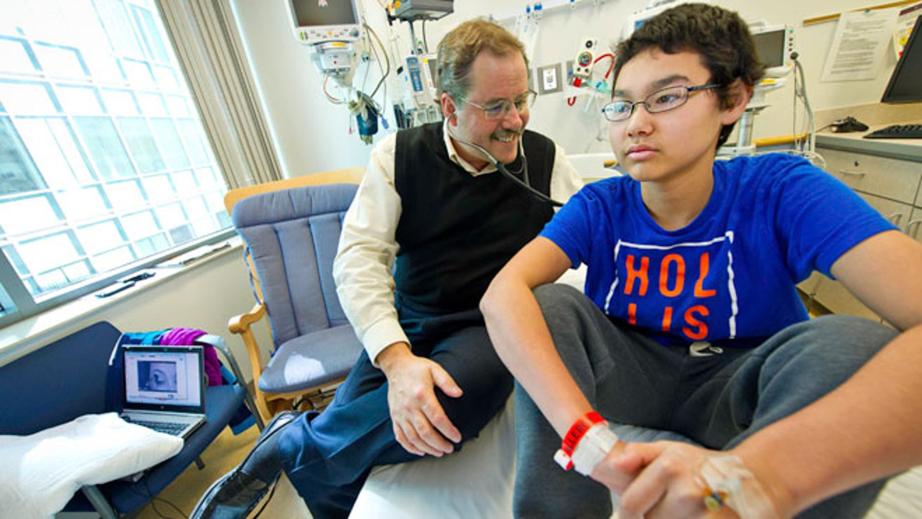 Dr. Stephan Grupp, of the Children's Hospital of Philadelphia (CHOP), with patient Nick Wilkins.