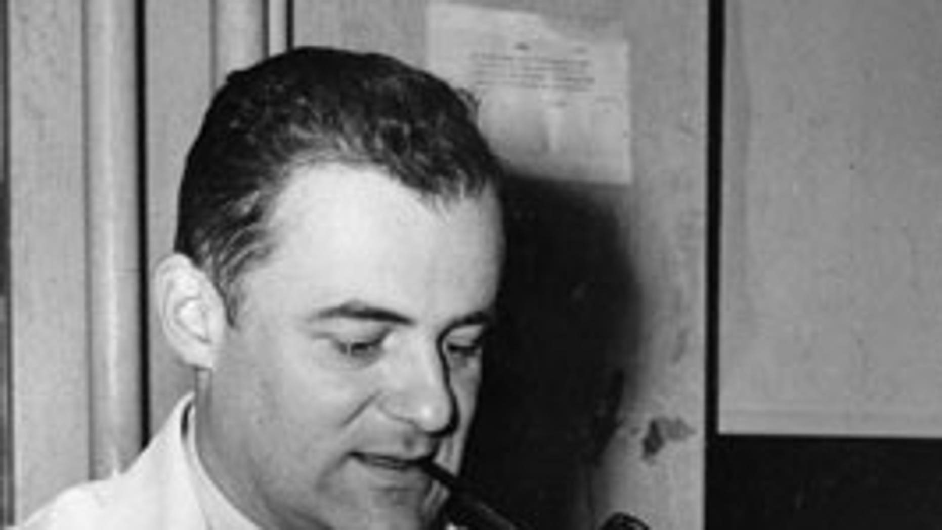 This Oct. 21, 1954 file photo shows Dr. Frederick C. Robbins, new chief of pediatrics and contagious diseases at Cleveland City Hospital, after the announcement that he, Dr. John Enders and Dr. Thomas Weller were awarded the Nobel prize for medicine. The 1954 Nobel Prize in medicine was awarded for work with fetal tissue that led to developing a vaccine against polio.