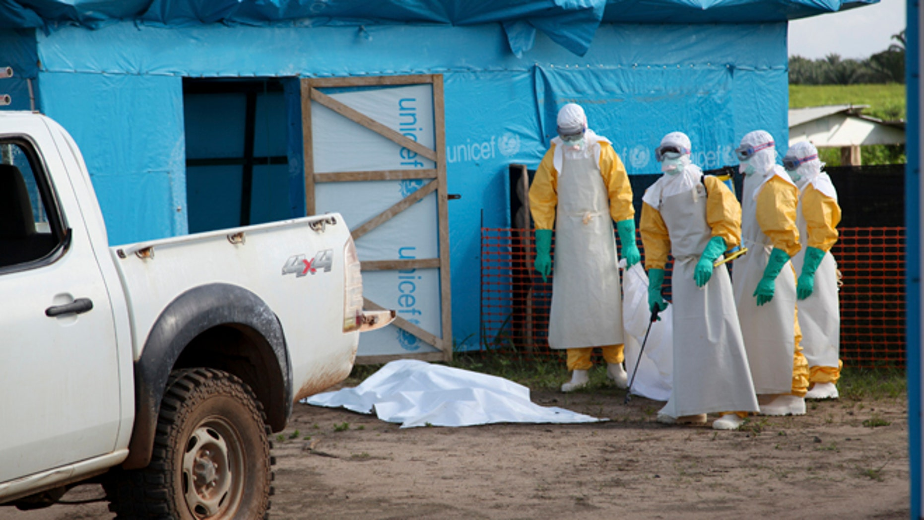 Health workers, wearing head-to-toe protective gear, prepare for work, outside an isolation unit in Foya District, Lofa County, Liberia in this July 2014 UNICEF handout photo. As of July 27, 2014, a total of 1,323 cases, including 729 deaths, had been attributed to Ebola virus disease (EVD) in the four West African countries of Guinea, Liberia, Nigeria and Sierra Leone. Liberia has borne 329 of these cases, including 156 deaths. REUTERS/Ahmed Jallanzo/UNICEF/Handout via Reuters  (LIBERIA - Tags: HEALTH) THIS IMAGE HAS BEEN SUPPLIED BY A THIRD PARTY. IT IS DISTRIBUTED, EXACTLY AS RECEIVED BY REUTERS, AS A SERVICE TO CLIENTS. FOR EDITORIAL USE ONLY. NOT FOR SALE FOR MARKETING OR ADVERTISING CAMPAIGNS. MANDATORY CREDIT - RTR40Z0Y
