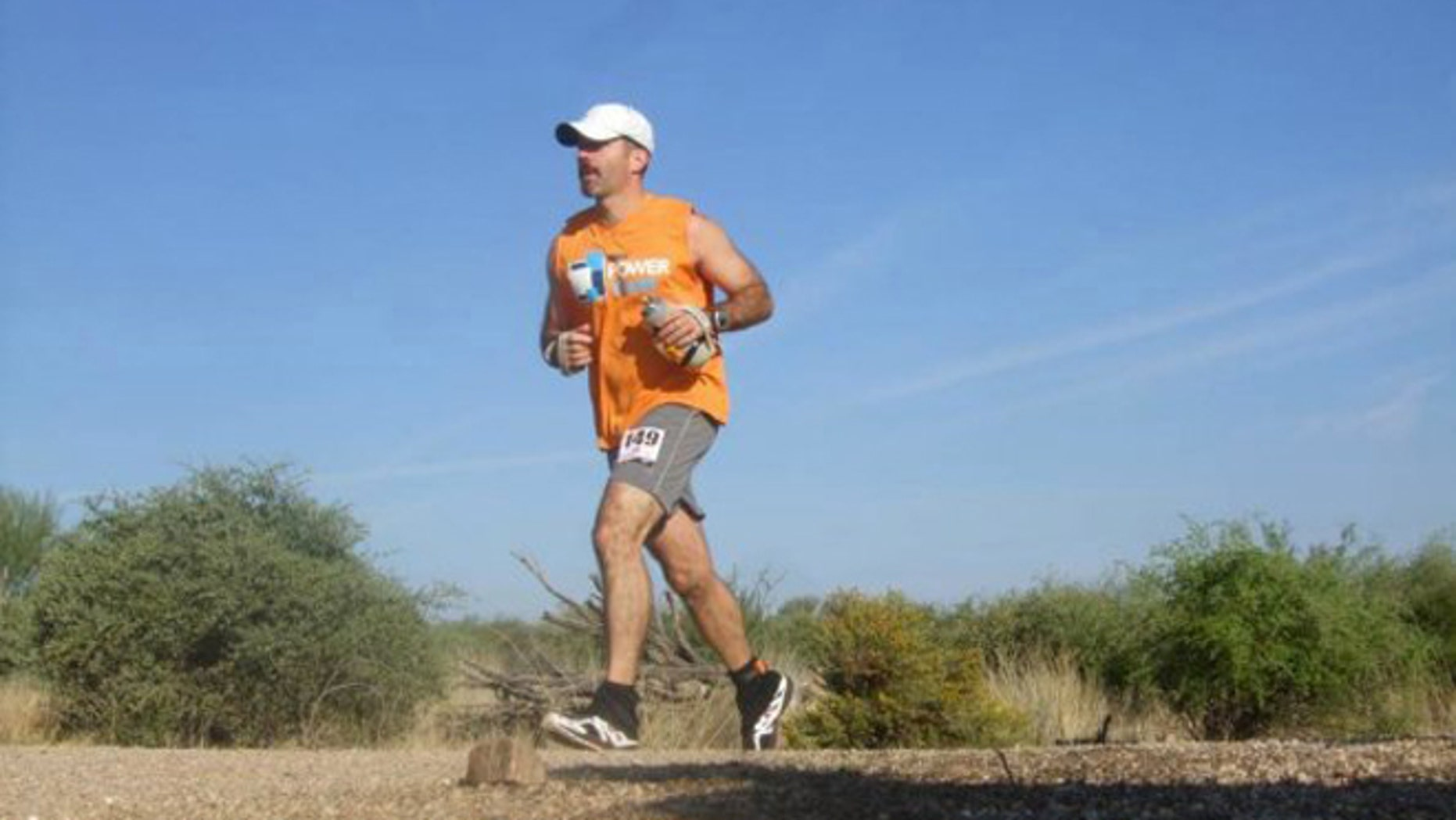 Eric Gelber, 46, wearing his signature MMRF Power Team t-shirt, trains for his first Super Ultra run; the 'Catskill 155: Journey for a Cure' in August 2011. COURTESY: Multiple Myeloma Research Foundation