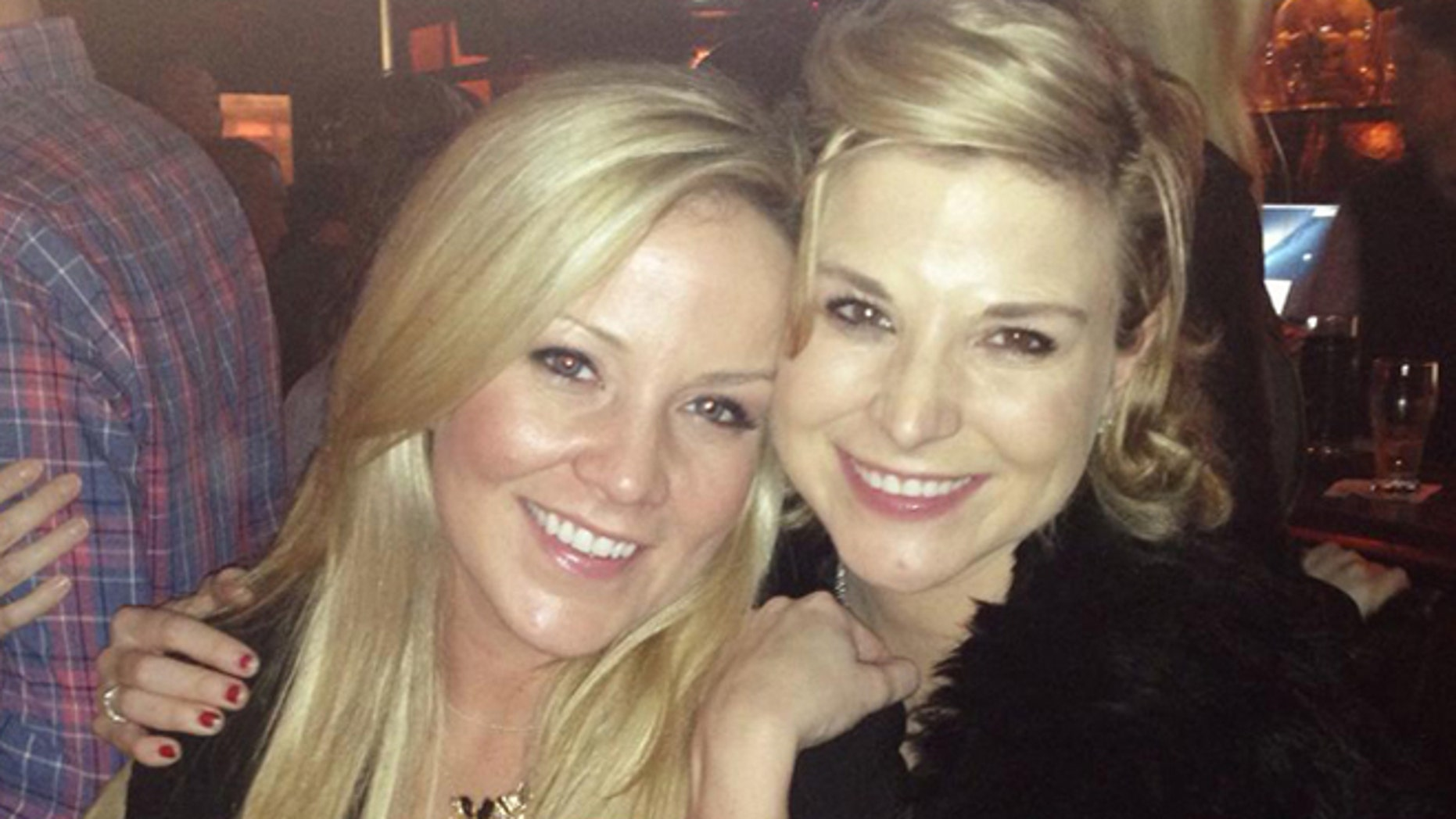 Megan and Diem Brown pose together in January 2014 in New York. Diem Brown lost her battle with cancer later that year in November 2014.