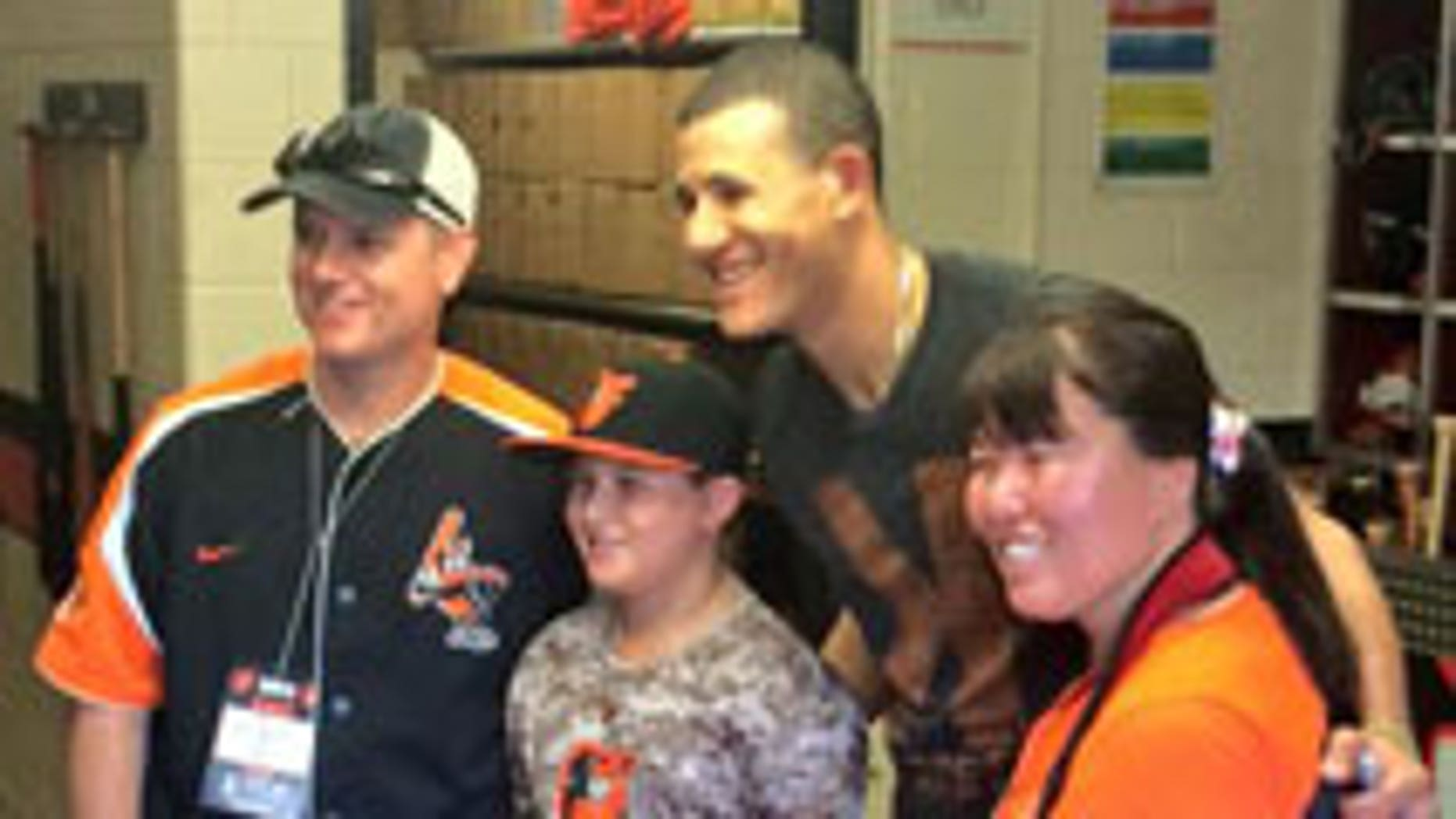 Hailey meets her favorite player, Manny Machado, whom she threw the first pitch to.