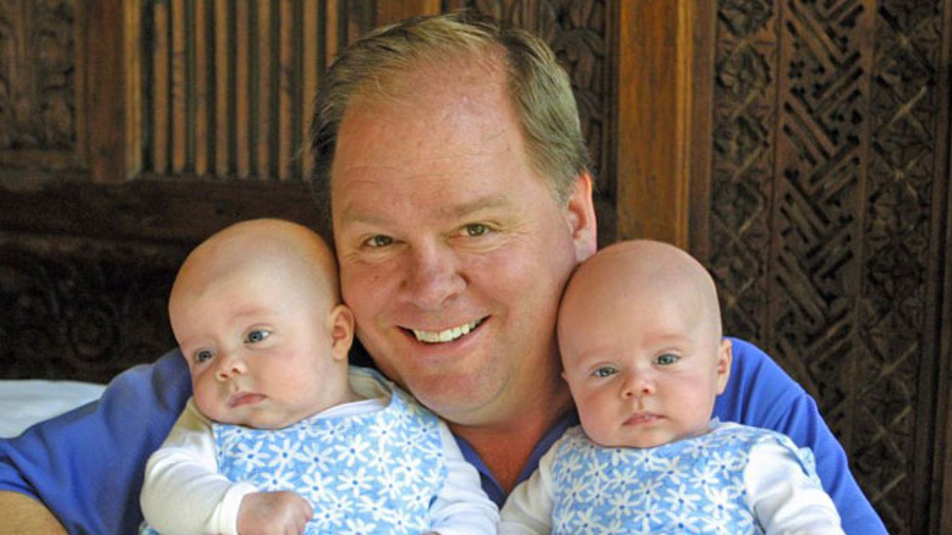 Hugh Hempel with his twin daughters, Addi and Cassi.