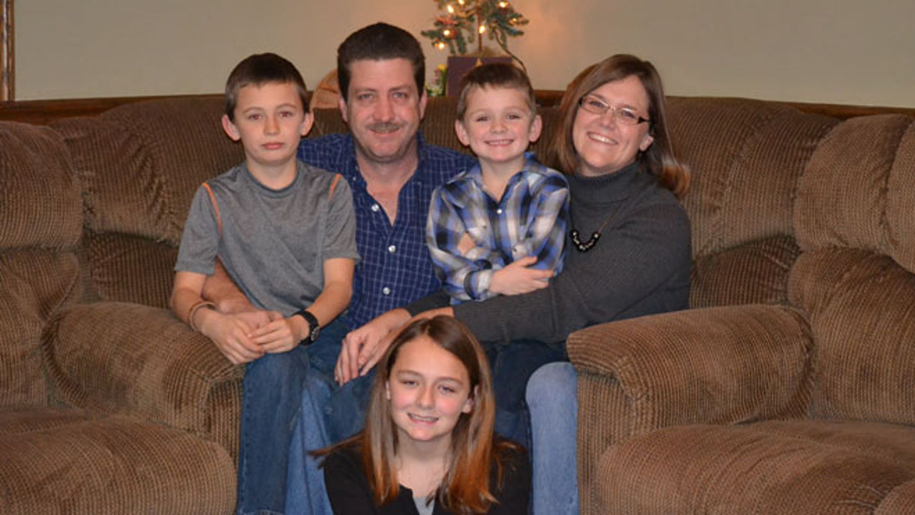 From back to center: Mandy and Jeff Holt, Ethan, 11 (left), Elliot, 7 (right), and Emily, 15 (center).