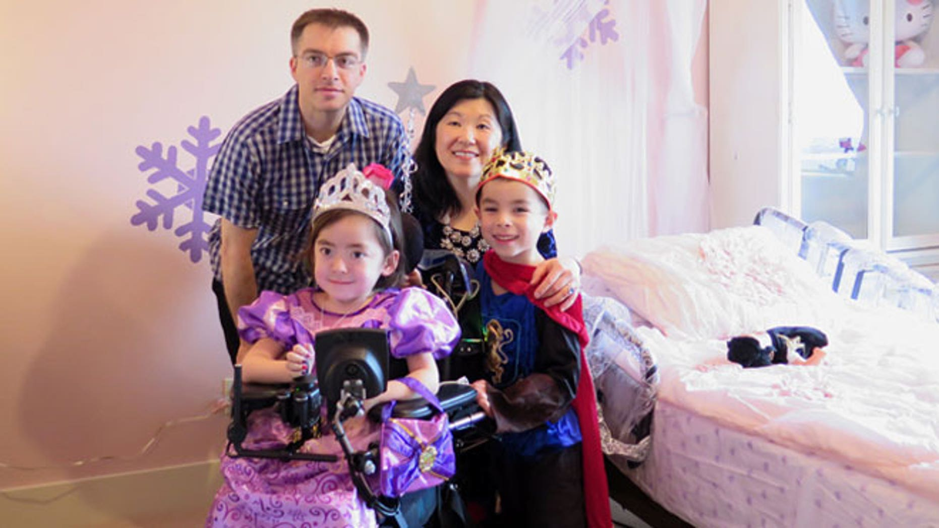 Julianna Snow, 5— pictured here with her father, Steve, her mother, Michelle Moon, and her older brother, Alex— suffers from a severe form of the inherited condition Charcot-Marie-Tooth disease, or CMT, that makes it impossible to eat on her own, play or walk. Her family told her at age 4 that the next time she got seriously ill, she could choose to either stay home and go to heaven or go back to the hospital.