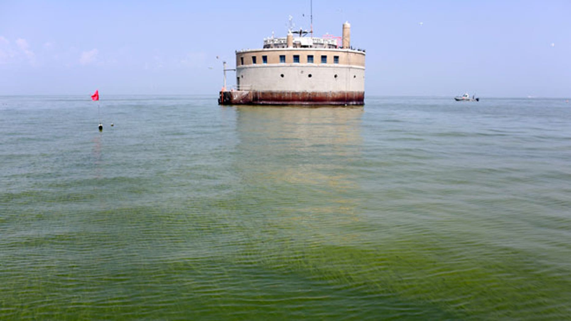 In this Aug. 3, 2014, file photo, the City of Toledo water intake crib is surrounded by algae in Lake Erie, about 2.5 miles off the shore of Curtice, Ohio. Toledo has detected the first signs in Lake Erie of the dangerous toxin that resulted in a water crisis last year that left 400,000 people in northwestern Ohio and southeastern Michigan without safe tap water for two days announced Monday, July 27, 2015.