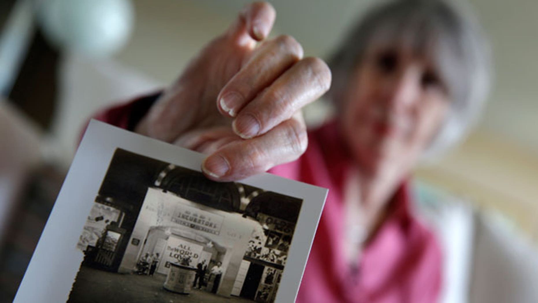 In this photo taken, Thursday, July 23, 2015, Beth Allen displays a photograph at her home in Hackensack, N.J., taken by her father after she was born premature in 1941. A century before reality TV, premature infants were put on display in primitive incubators. People paid 25 cents to see them at world's fairs, on the Atlantic City boardwalk, the sideshows at Coney Island and elsewhere. It was the only option for parents desperate to keep their babies alive, and Dr. Martin Couney did his best to oblige. From 1903 to 1943, Couney estimated, he kept alive 7,500 of the 8,500 children that passed through his incubator sideshows.
