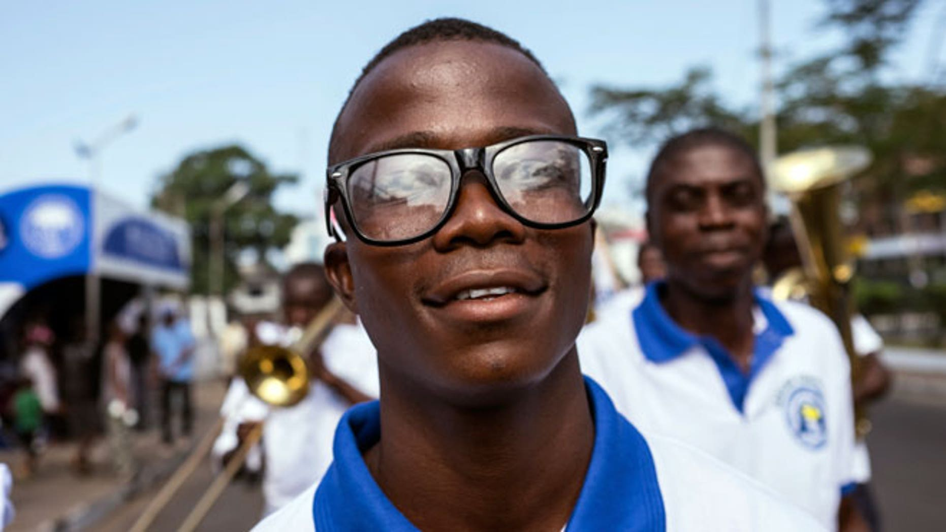 Ebola survivor Musa Pabai walks in an Ebola Survivors Valentine's Day parade in Monrovia, February 14, 2015.
