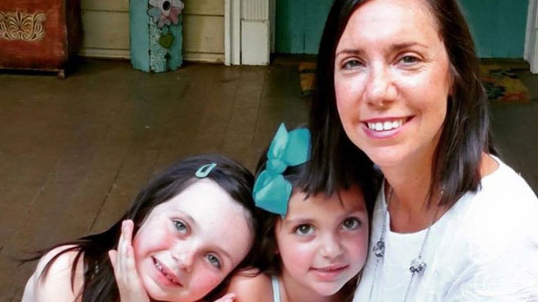 Stephanie Ballard is pictured with her two daughters, Riley, 6, and Reese, 4.