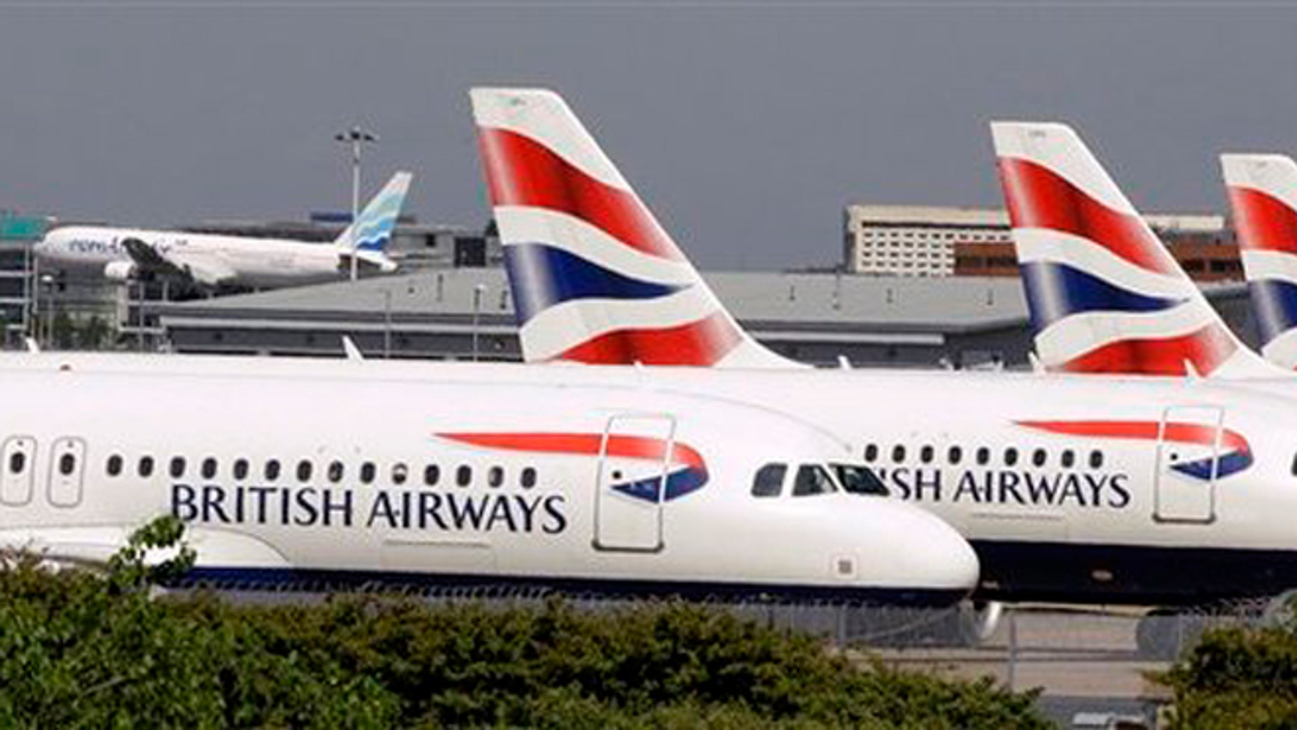 British Airways planes parked at Heathrow Airport in London.