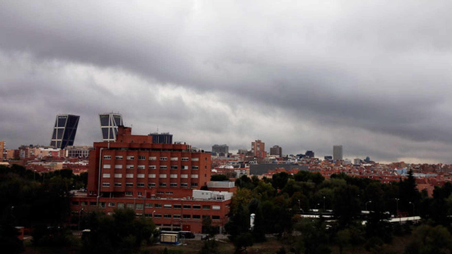 Rainy clouds pass over Madrid's Carlos III Hospital (L, brick building), where Spanish nurse Teresa Romero Ramos who contracted Ebola is hospitalized, in Madrid October 11, 2014.