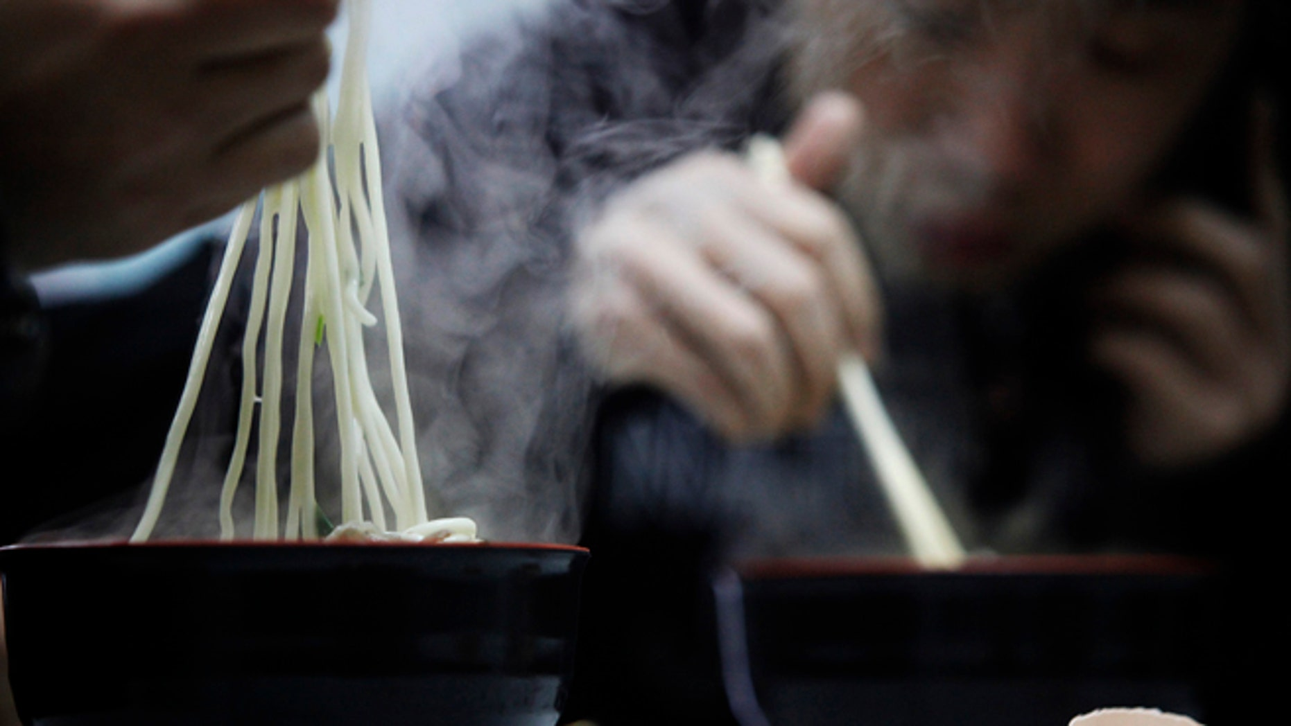 """People eat noodles in a restaurant in Shanghai March 2, 2009. China said on Monday food security remains """"grim"""" despite campaigns launched after several health scares, the most recent last year's tainted milk formula which killed at least six toddlers and made almost 300,000 sick. REUTERS/Aly Song (CHINA)"""